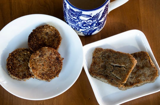 Jones Country Style Scrapple, right, and Glier's Goetta, left,   cooked by Polly Campbell for comparison on Tuesday, Dec. 18, 2018, in Cincinnati.