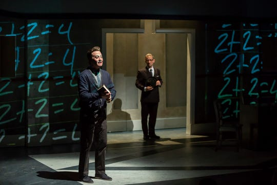 "Justin McCombs (L) as the beleaguered Winston Smith and Jeremy Dubin as O'Brien in Cincinnati Shakespeare Company's 2018 stage adaptation of George Orwell's ""1984."""