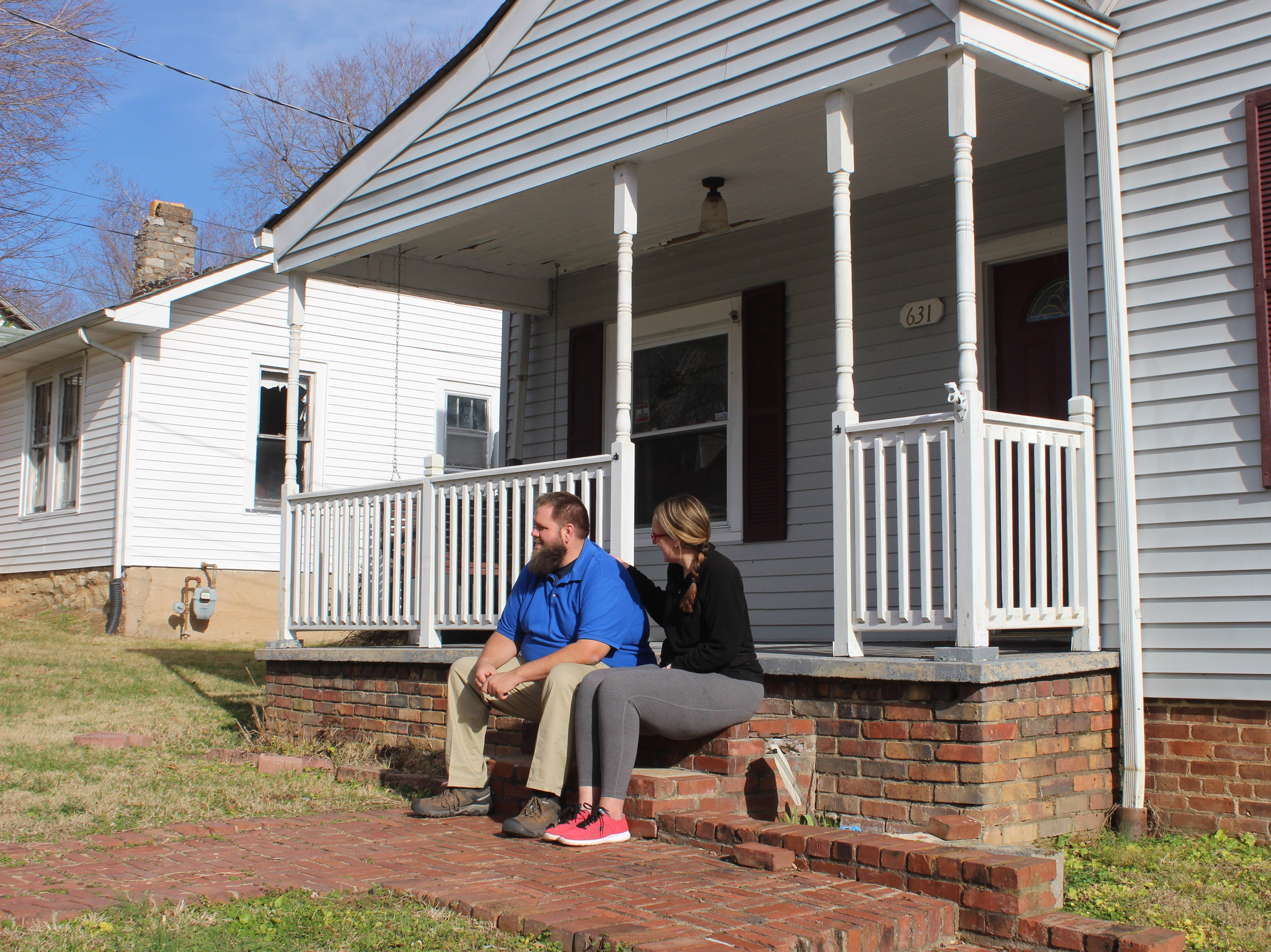 Billy and Dixie Womble on the porch of their Martin Street home, which borders property being considered for a rezoning to allow Loaves & Fishes to build their new facility there.