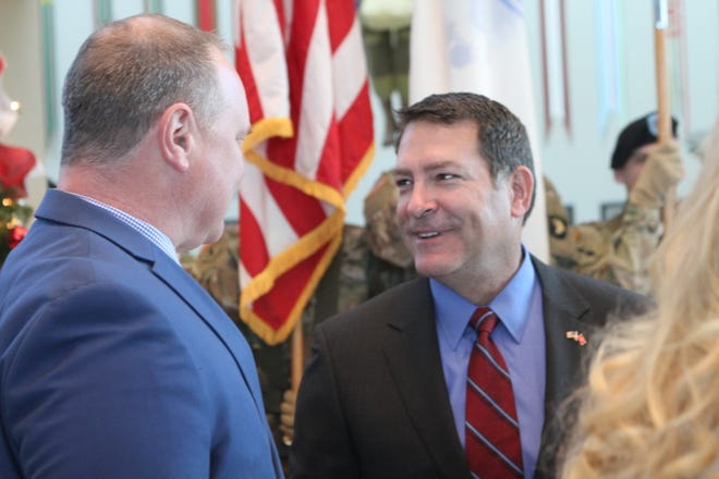 Congressman-elect Mark Green speaks with Montgomery County Chief of Staff Jeff Truitt at the uncasing of the 101st Airborne Division colors following its Afghanistan deployment, on Wednesday, Dec. 19, 2018.