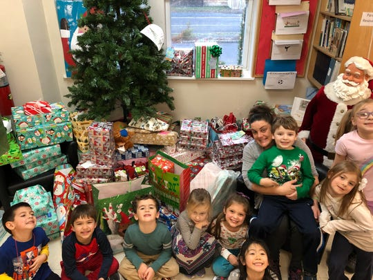 Kindergarten teacher Melissa Reilly-Grecco with Kangaroo Kids Kindergarten class and the presents going to the Appalachian Community of West Virginia.