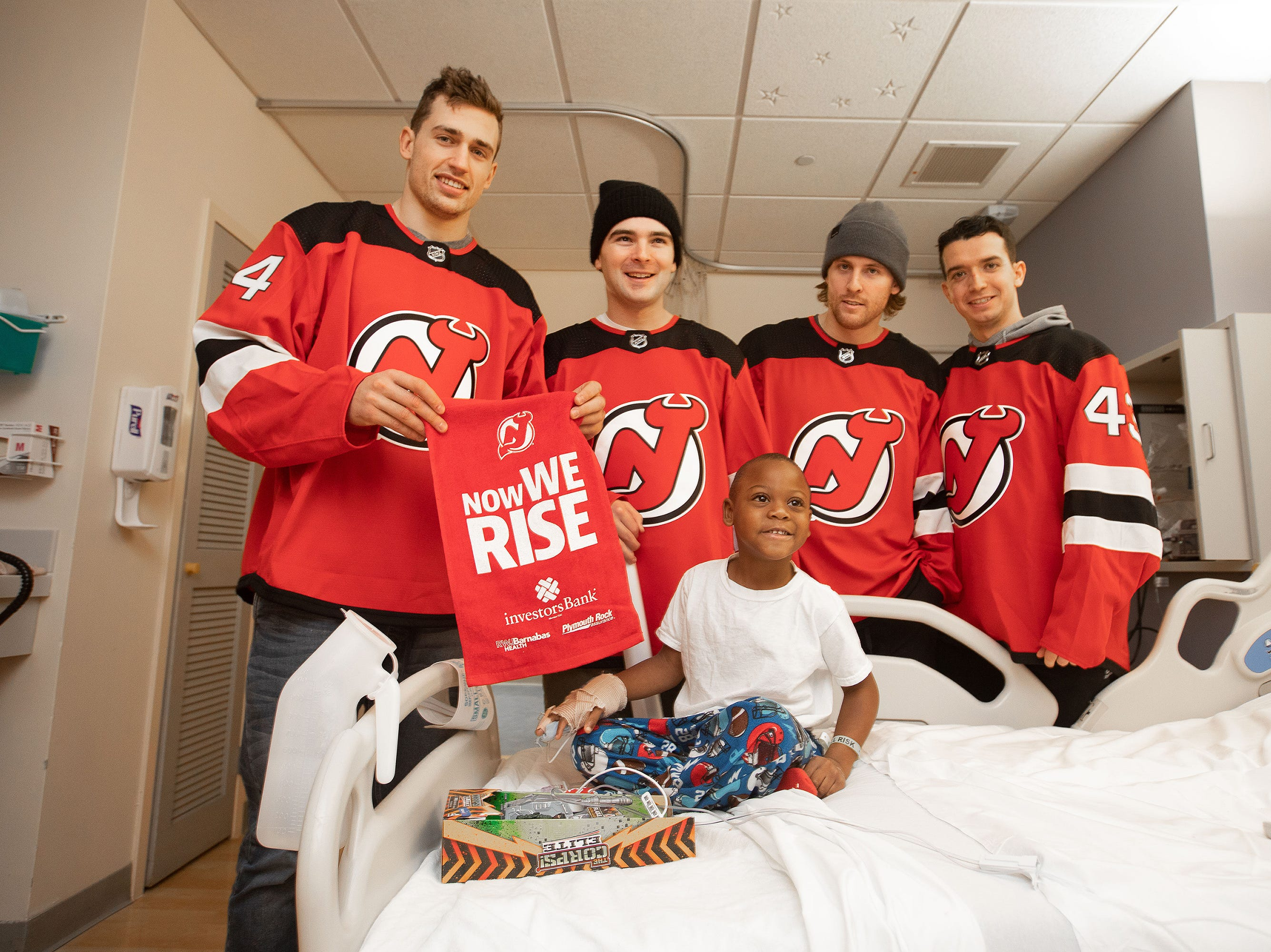 Patients and staff at Robert Wood Johnson University Hospital and Bristol Meyers Squibb Hospital in New Brunswick enjoyed some holiday cheer on Dec. 17 as New Jersey Devils Will Butcher, Blake Coleman, Brett Seney and Miles Wood spent the afternoon visiting with patients, delivering toys, signing autographs and taking photos.