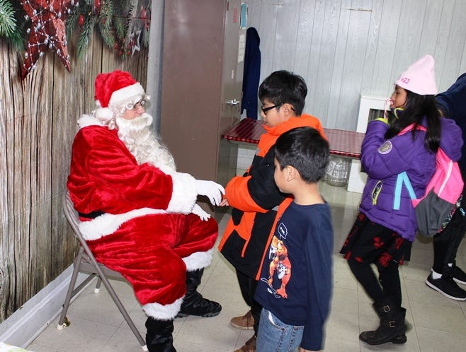 On Dec. 15, New Brunswick children were treated to a pre-Christmas visit from Santa Claus when he arrived at the 25th Annual Holiday Festival for Children at the Suydam Street Reformed Church. The celebration, sponsored by the Robert Wood Johnson University Hospital Community Health Promotion Program, the Suydam Street Reformed Church Health Ministry and the New Brunswick Police and Fire Department, marked the Festival's 25th anniversary of bringing joy to New Brunswick children, many of whom have grown up to volunteer at the event as New Brunswick police officers and firefighters.