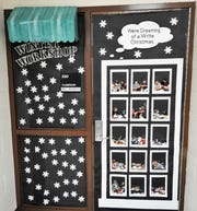 Coshocton Elementary School had a Christmas door decoration contest for the first time this school year. The classroom of Kathy Robbins had a winter workshop theme.