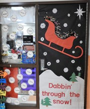The classroom of Title I teacher Carlye Shaw won most creative for a Christmas door decorating contest at Coshocton Elementary School.