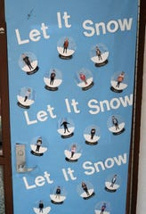 The fifth grade class of Peggy Bowman won for most neat in a door decorating contest for Christmas at Coshocton Elementary School.
