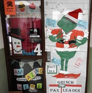 Most school spirit was awarded to the fourth grade class of Donna Yoder for incorporating the Pax Leader idea, a school program, into their design for a Christmas door decorating contest at Coshocton Elementary School.