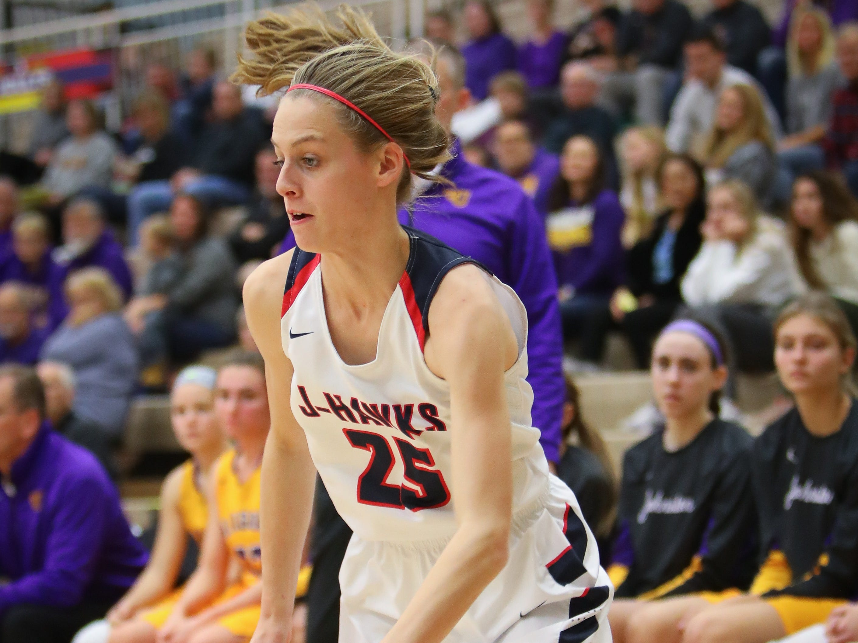 Urbandale sophomore Macy Gaskill drives the ball to the hoop during a girls high school basketball game between the Johnston Dragons and the Urbandale J-Hawks at Urbandale High School on Dec. 18, 2018 in Urbandale, Iowa.