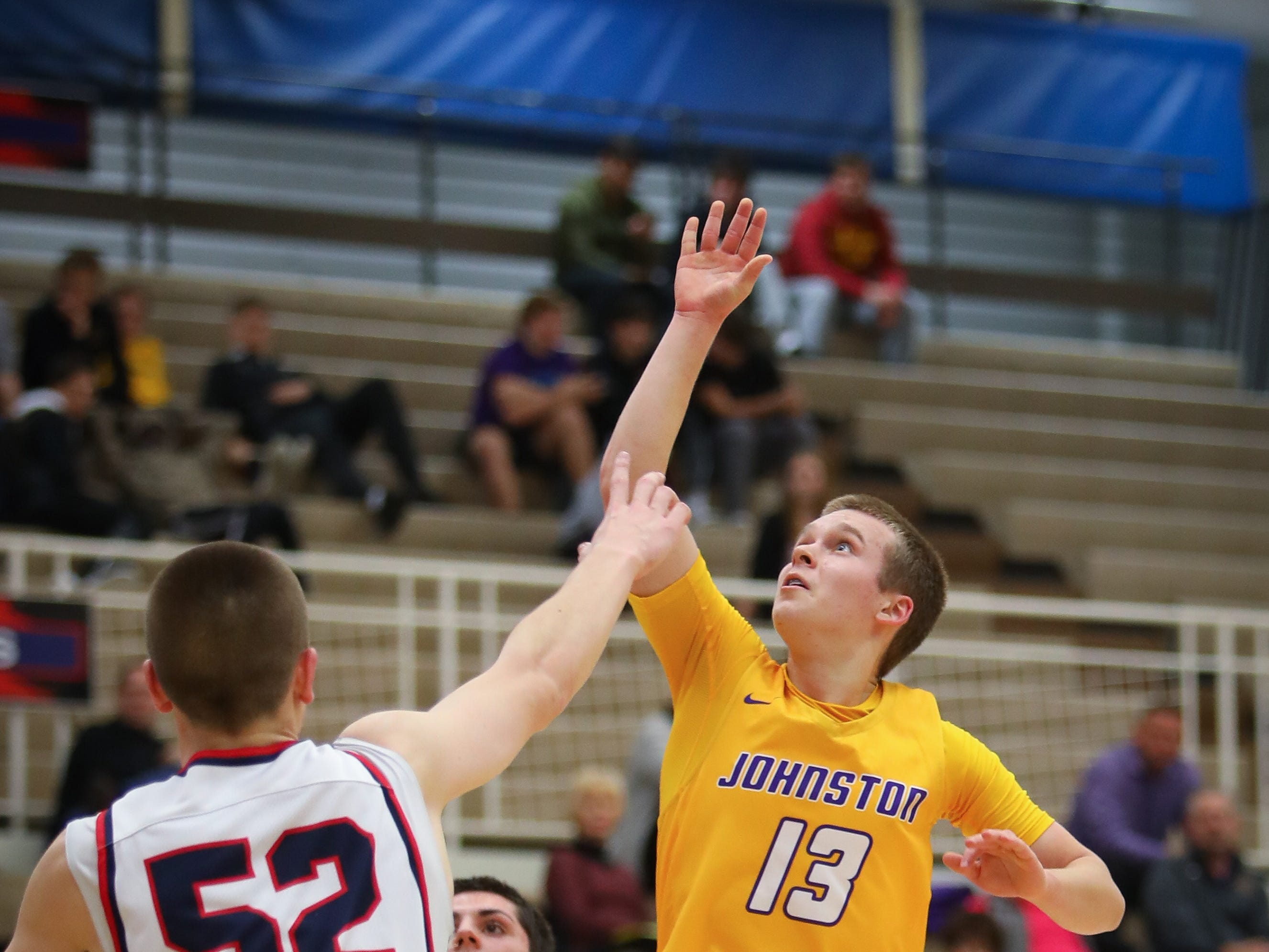 Johnston freshman Jacob Runyan floats one in during a boys high school basketball game between the Johnston Dragons and the Urbandale J-Hawks at Urbandale High School on Dec. 18, 2018 in Urbandale, Iowa.