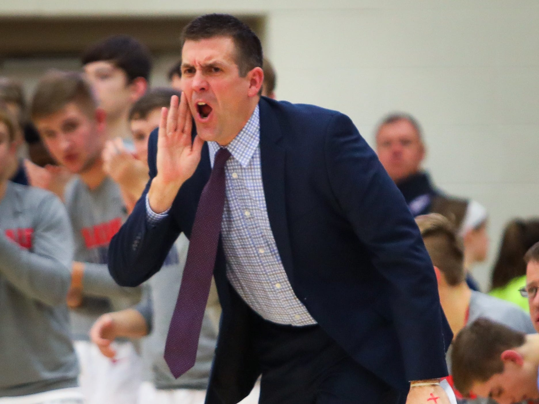 Urbandale head coach Jon Schmitz yells out instructions to his players during a boys high school basketball game between the Johnston Dragons and the Urbandale J-Hawks at Urbandale High School on Dec. 18, 2018 in Urbandale, Iowa.