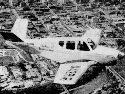 """The last Register & Tribune plane was """"Good News XI,"""" another four-passenger Bonanza purchased in 1955. XI is pictured flying above Des Moines and, according to a story in the Register, could reach any corner of the state in less than 50 minutes."""