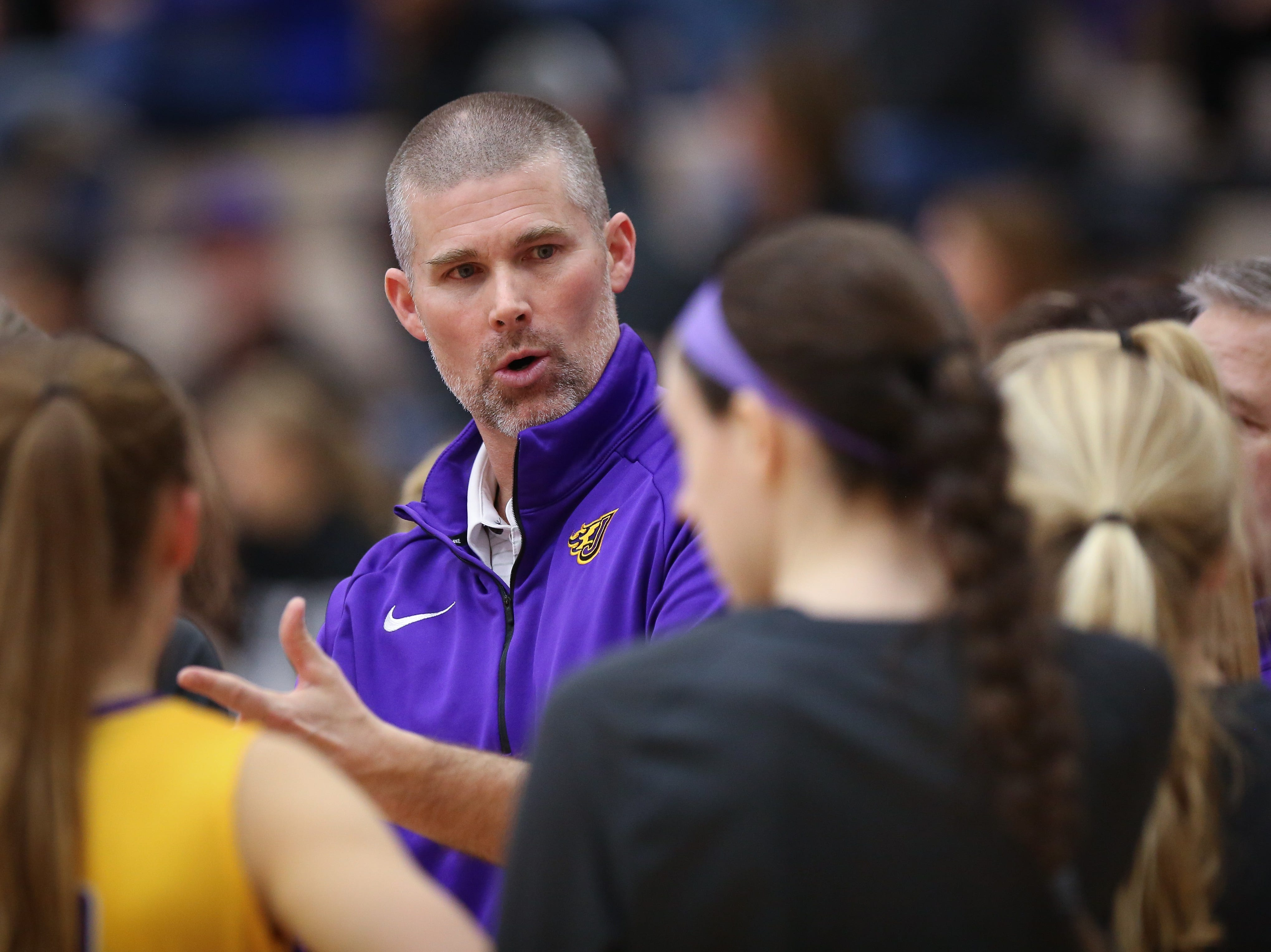 Johnston head coach Chad Jilek gives instructions to his players during a girls high school basketball game between the Johnston Dragons and the Urbandale J-Hawks at Urbandale High School on Dec. 18, 2018 in Urbandale, Iowa.