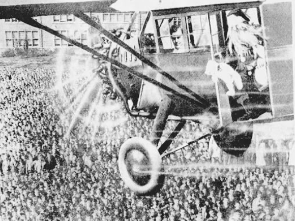 """From 1928: A Register & Tribune artist drew Santa Claus in the newspaper's """"Good News"""" airplane flying over thousands of Des Moines children awaiting his arrival."""