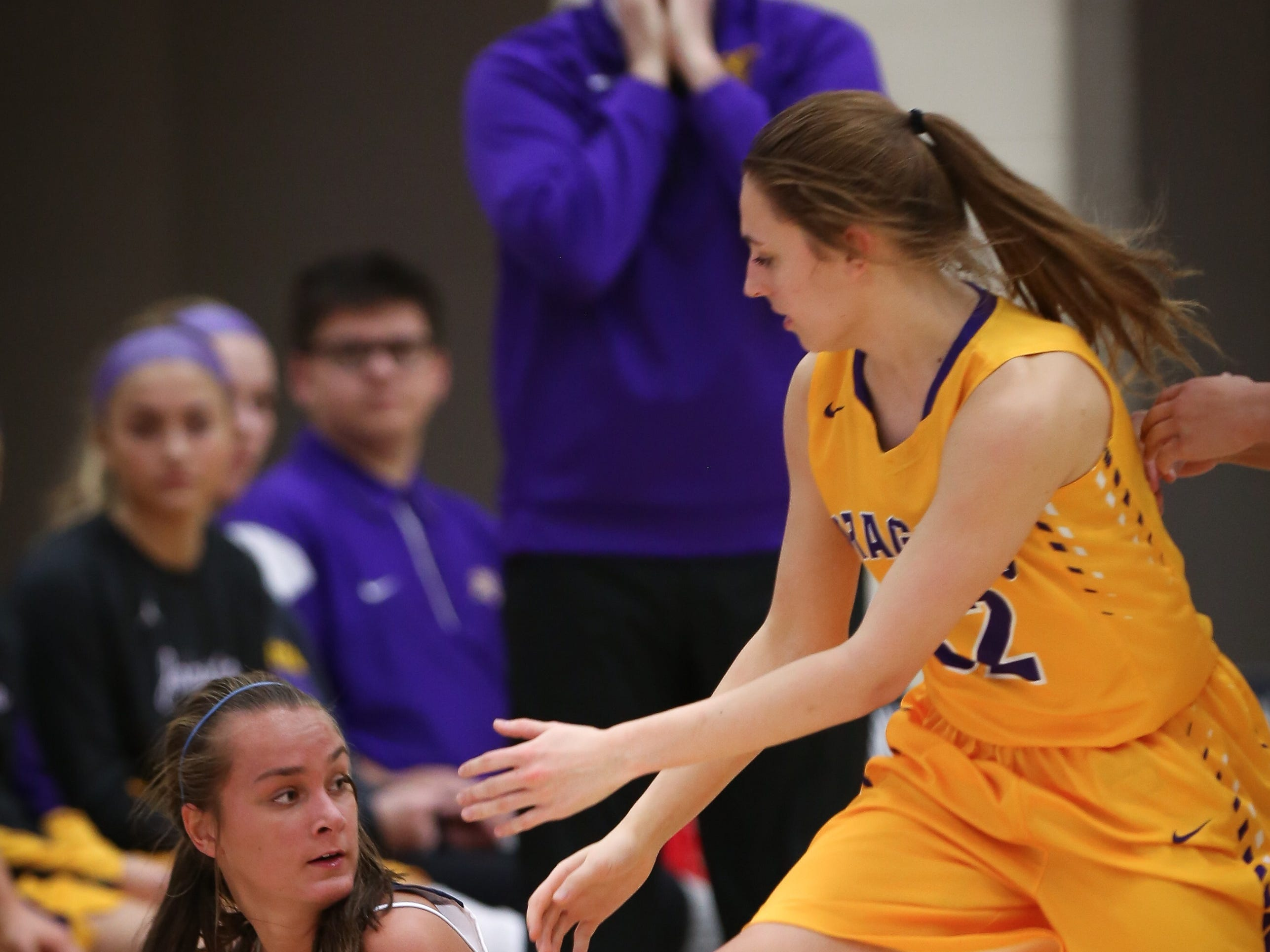 Urbandale sophomore Madi Lynch looks for an open teammate to pass to during a girls high school basketball game between the Johnston Dragons and the Urbandale J-Hawks at Urbandale High School on Dec. 18, 2018 in Urbandale, Iowa.