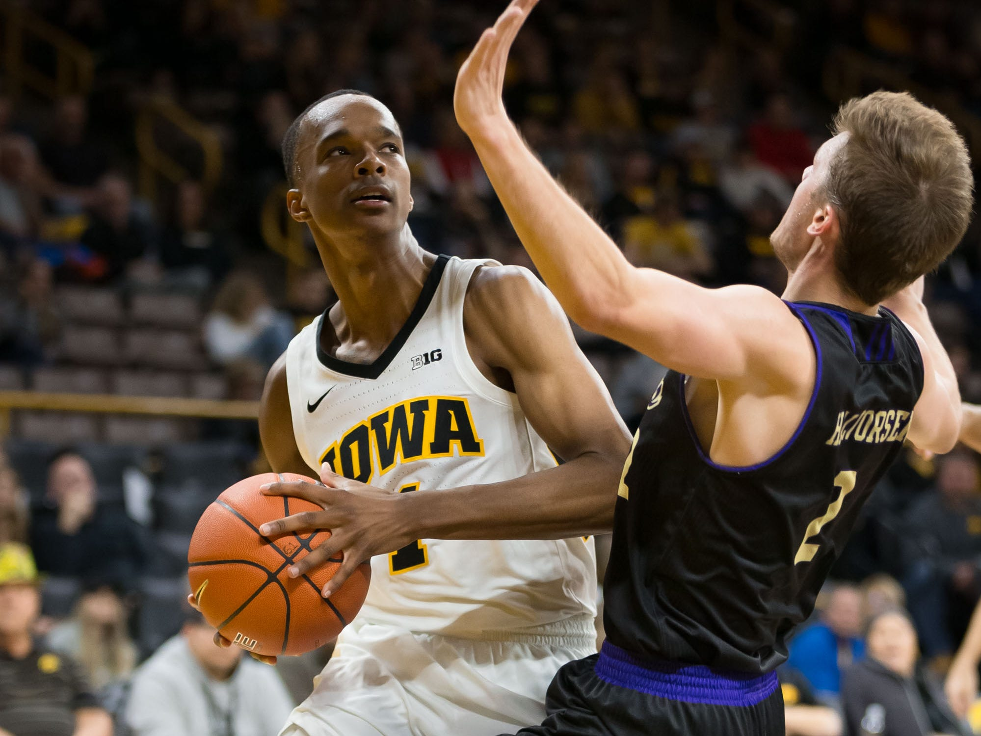 Iowa junior guard Maishe Dailey (1) bumps into Western Carolina sophomore guard Matt Halvorsen (2) in the second half at Carver Hawkeye Arena in Iowa City on Tuesday, Dec. 18, 2018.