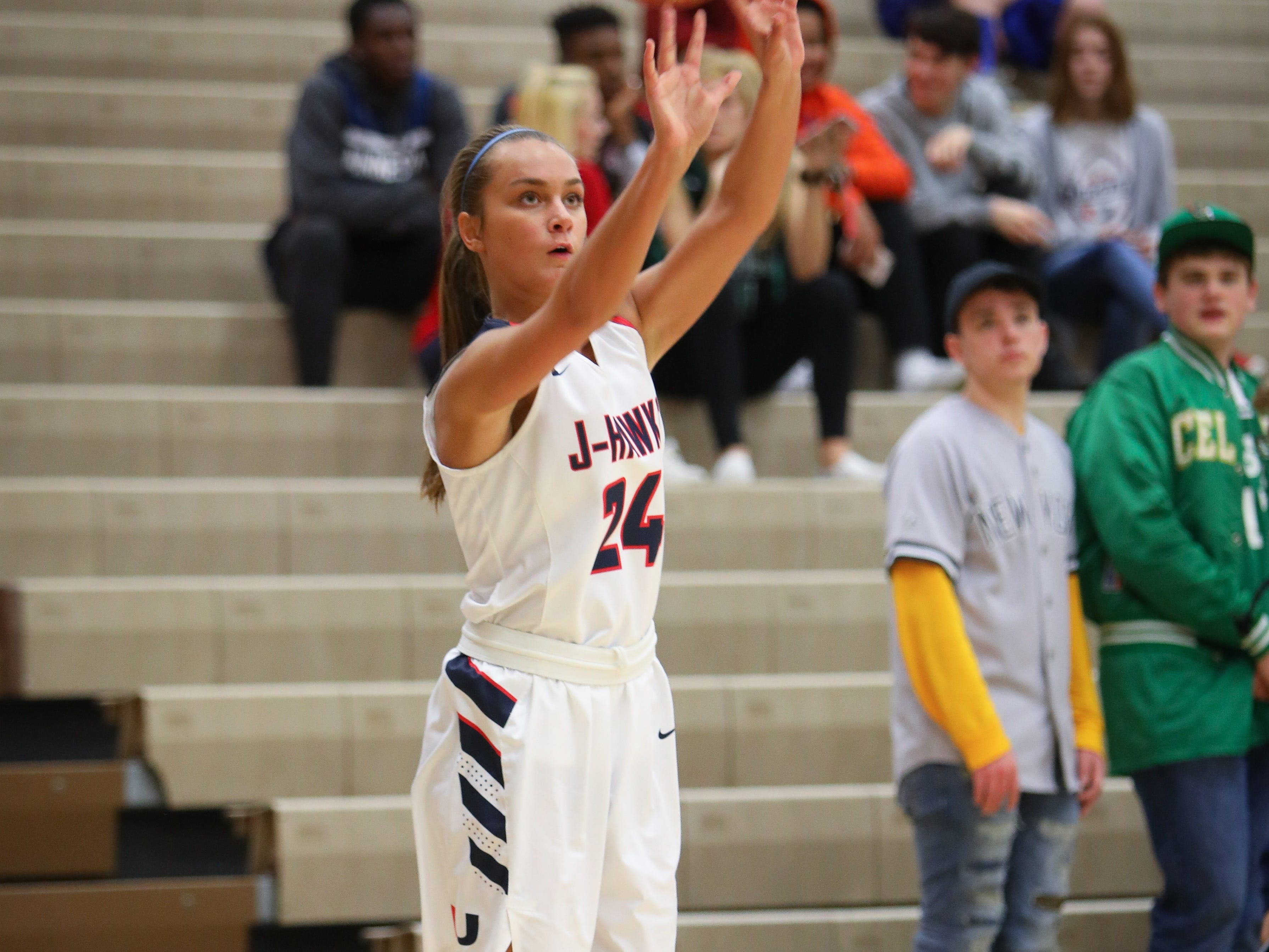 Urbandale sophomore Madi Lynch attempts a three-pointer during a girls high school basketball game between the Johnston Dragons and the Urbandale J-Hawks at Urbandale High School on Dec. 18, 2018 in Urbandale, Iowa.