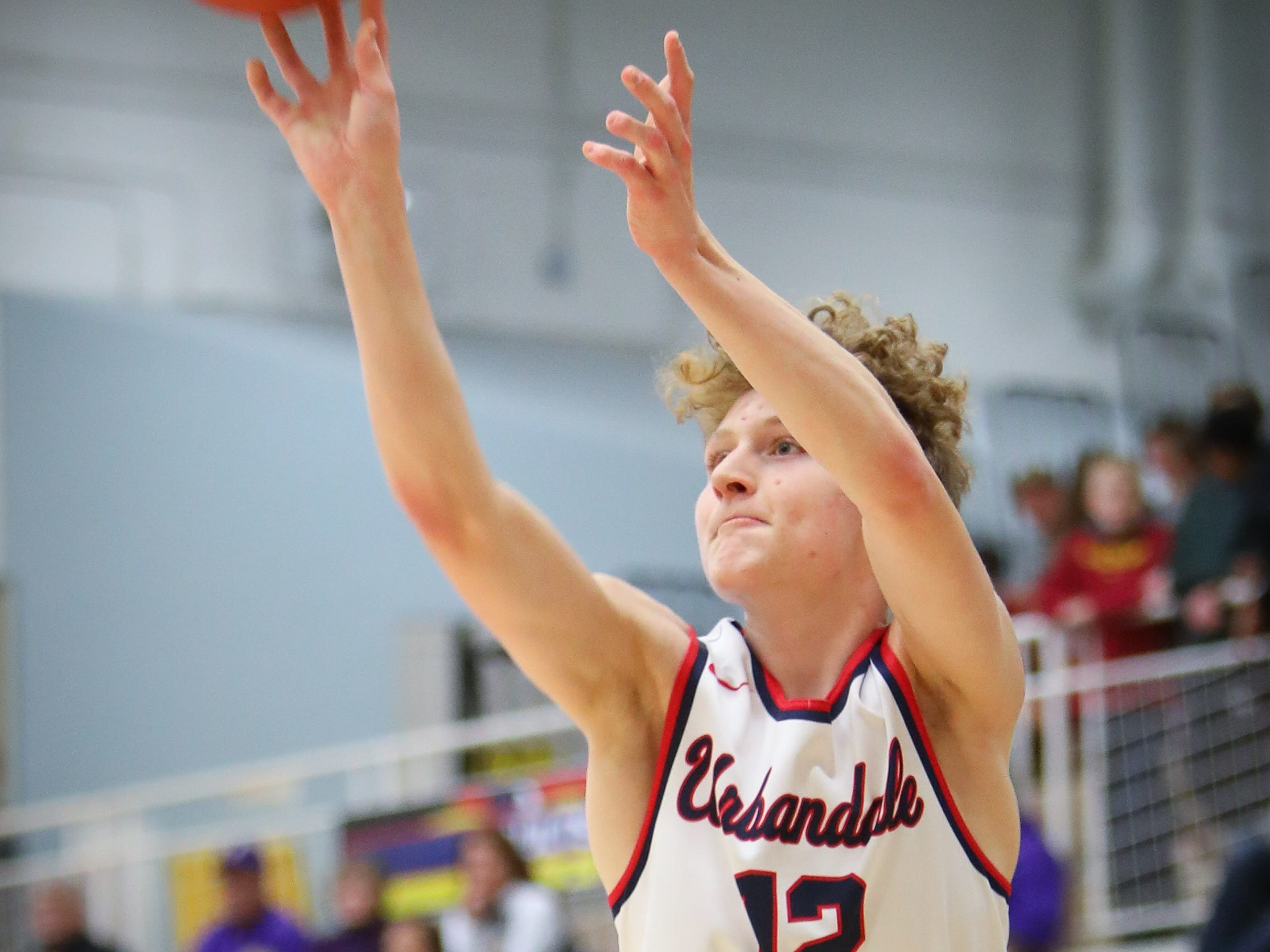Urbandale junior Seth Anderson attempts a three-pointer during a boys high school basketball game between the Johnston Dragons and the Urbandale J-Hawks at Urbandale High School on Dec. 18, 2018 in Urbandale, Iowa.