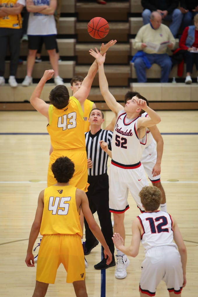 Johnston senior Peyton Williams and Urbandale junior Cal Watson go for the tip-off during a boys high school basketball game between the Johnston Dragons and the Urbandale J-Hawks at Urbandale High School on Dec. 18, 2018 in Urbandale, Iowa.