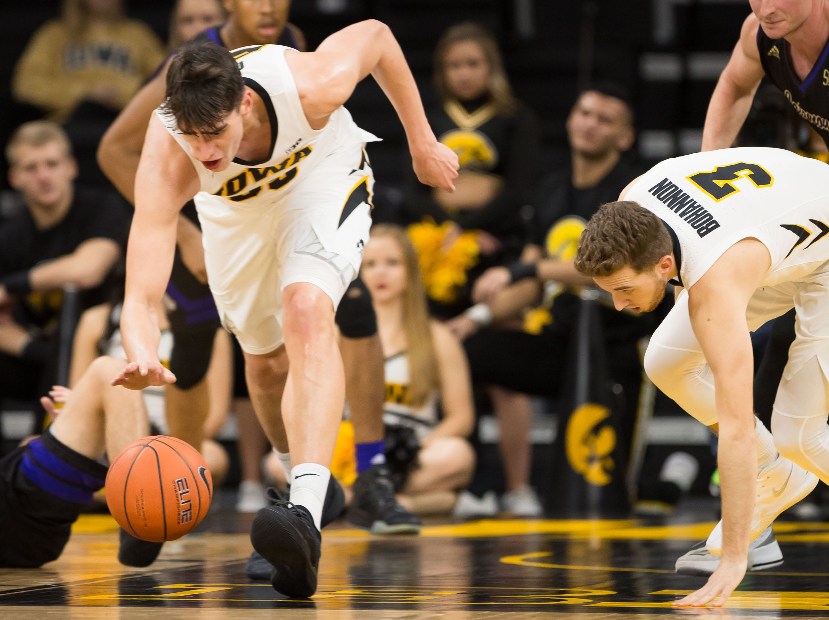 Iowa sophomore forward Luka Garza (55) scoops up the ball on the run in the second half at Carver Hawkeye Arena in Iowa City on Tuesday, Dec. 18, 2018.
