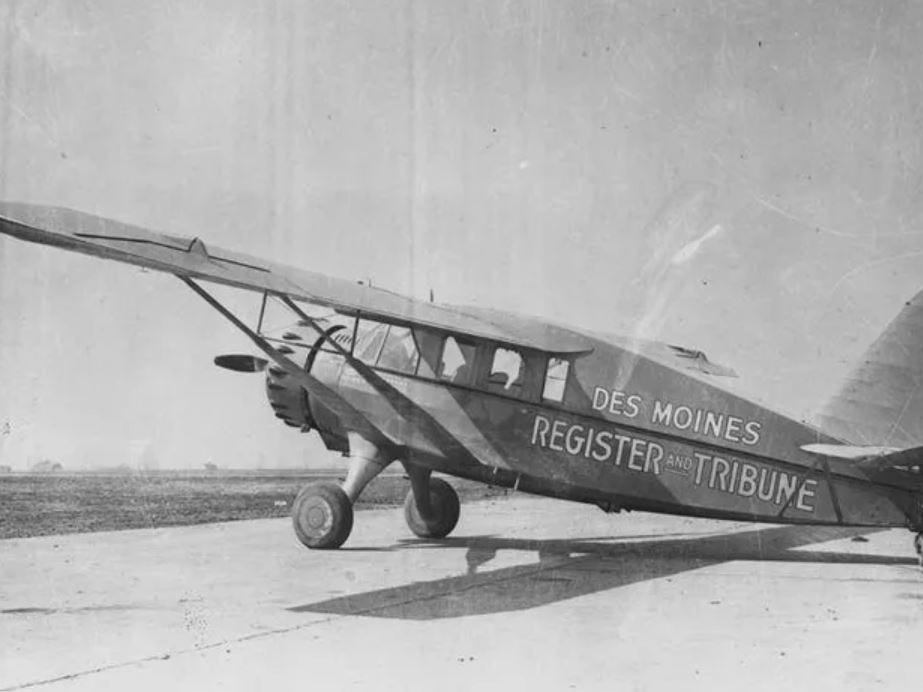 """From 1938: The Register & Tribune's bright orange Bellanca airplane, known as """"Good News IV."""""""