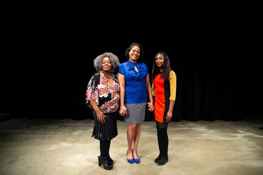Three of the founding members of the Pyramid Theatre Company, Claudine Cheatem, general manager, Tiffany Johnson, artistic director, and Alexis Davis, managing director, pose for a photo inside the Stoner Theater on Tuesday, Dec. 18, 2018, at the Des Moines Civic Center.