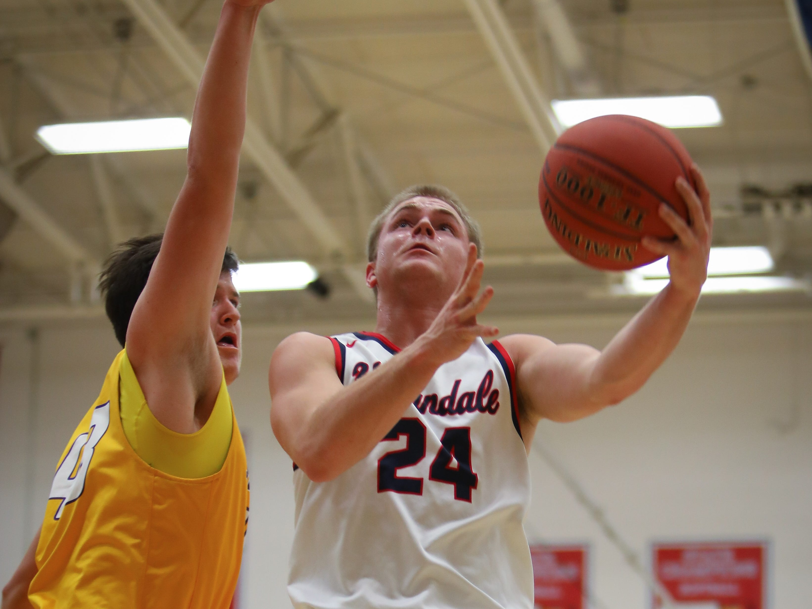 Urbandale senior Will Pattison goes for a layup during a boys high school basketball game between the Johnston Dragons and the Urbandale J-Hawks at Urbandale High School on Dec. 18, 2018 in Urbandale, Iowa.
