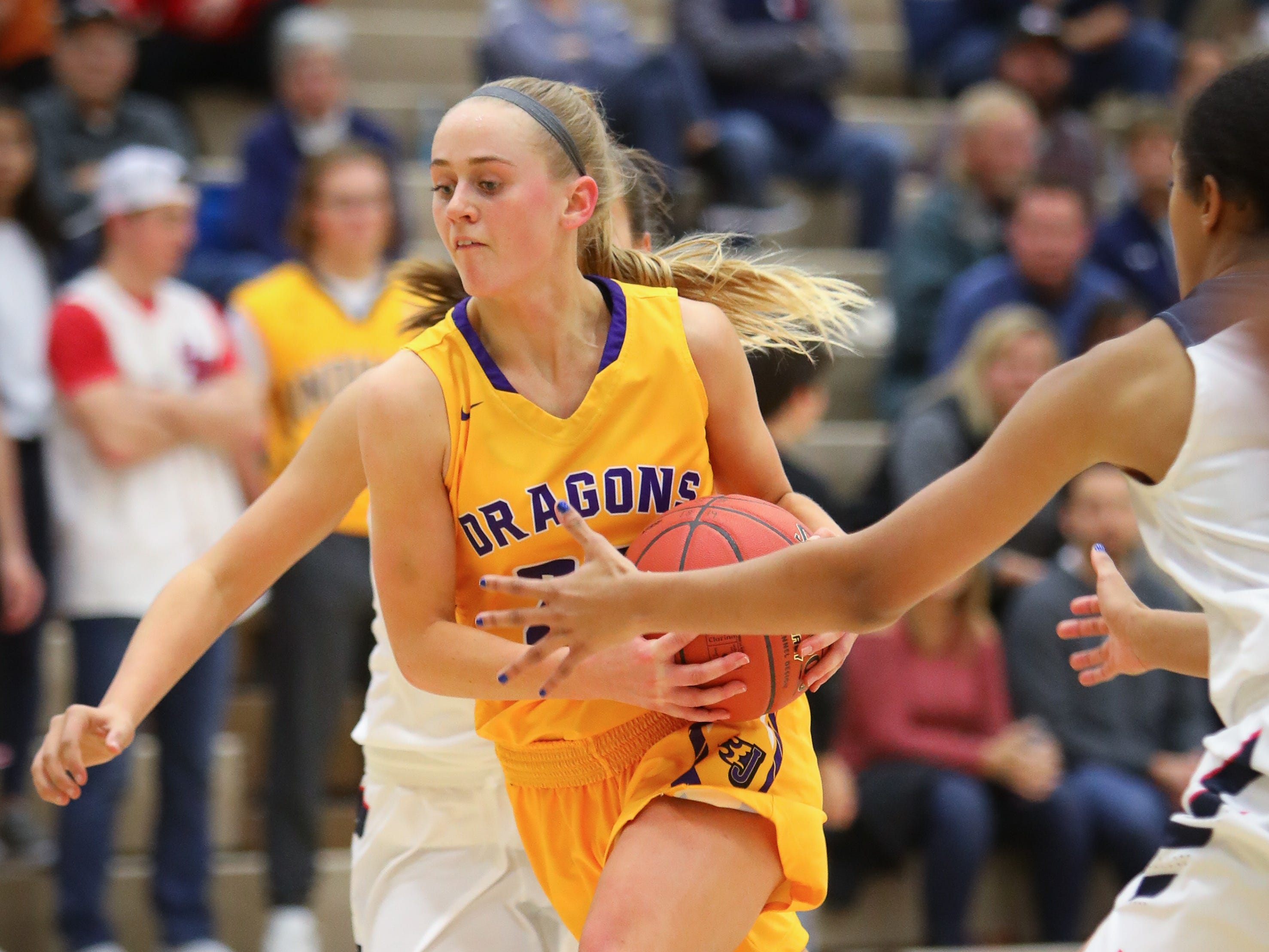 Johnston senior Macy Thompson weaves through traffic to the hoop during a girls high school basketball game between the Johnston Dragons and the Urbandale J-Hawks at Urbandale High School on Dec. 18, 2018 in Urbandale, Iowa.