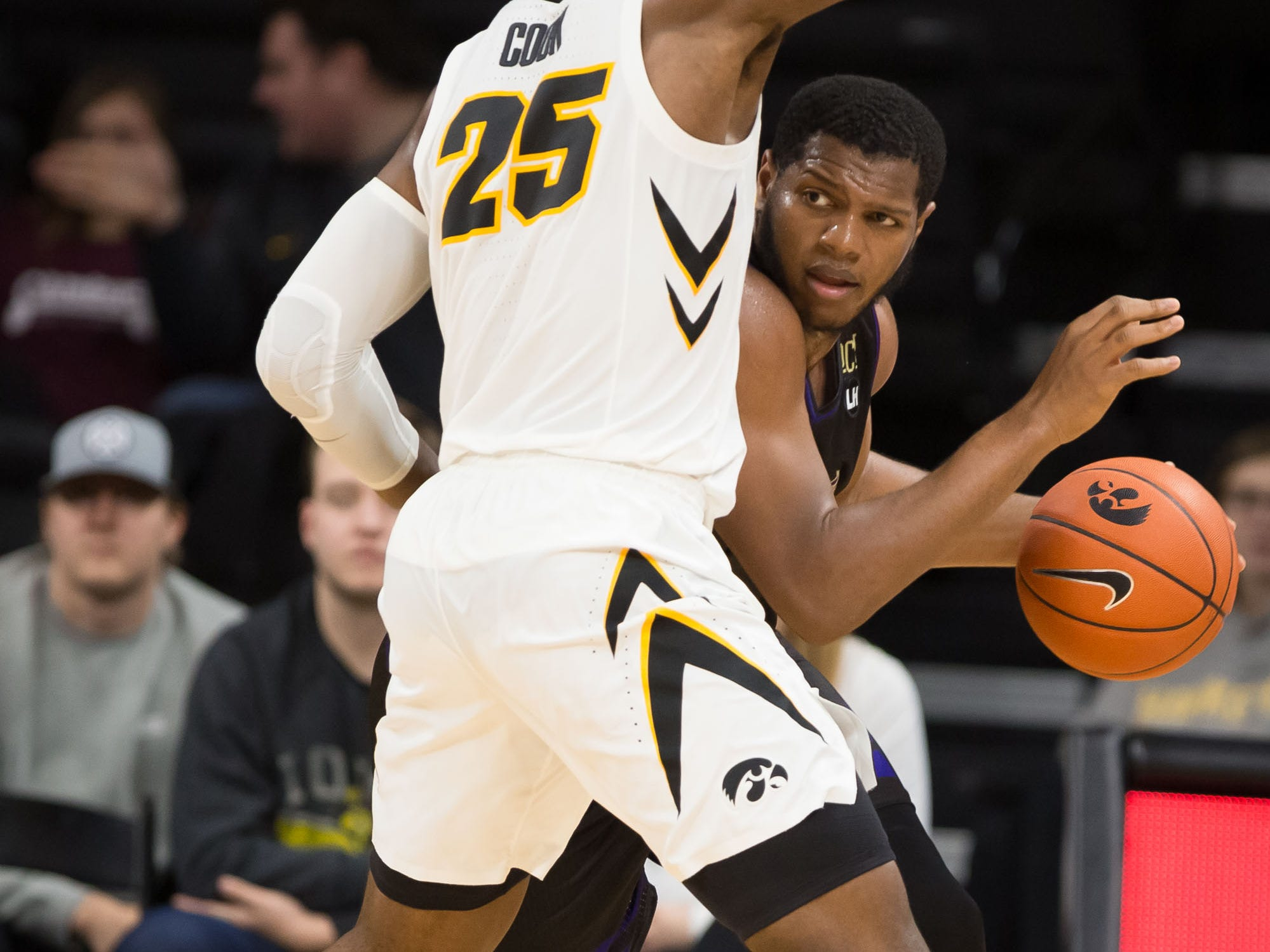 Western Carolina junior forward Carlos Dotson (4) drives against Iowa junior forward Tyler Cook (25) in the second half at Carver Hawkeye Arena in Iowa City on Tuesday, Dec. 18, 2018.