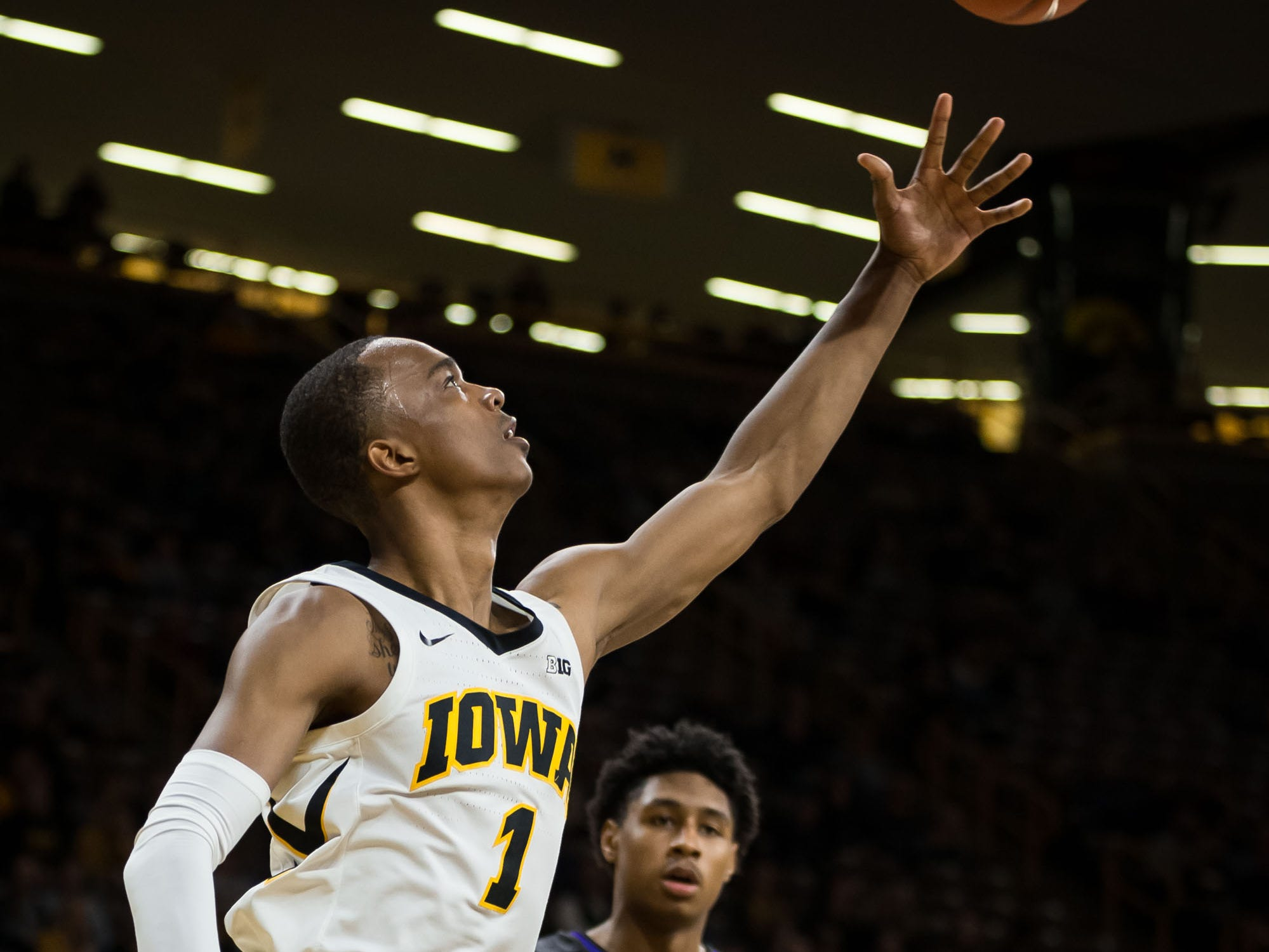 Iowa junior guard Maishe Dailey (1) shoots a layup in the second half at Carver Hawkeye Arena in Iowa City on Tuesday, Dec. 18, 2018.