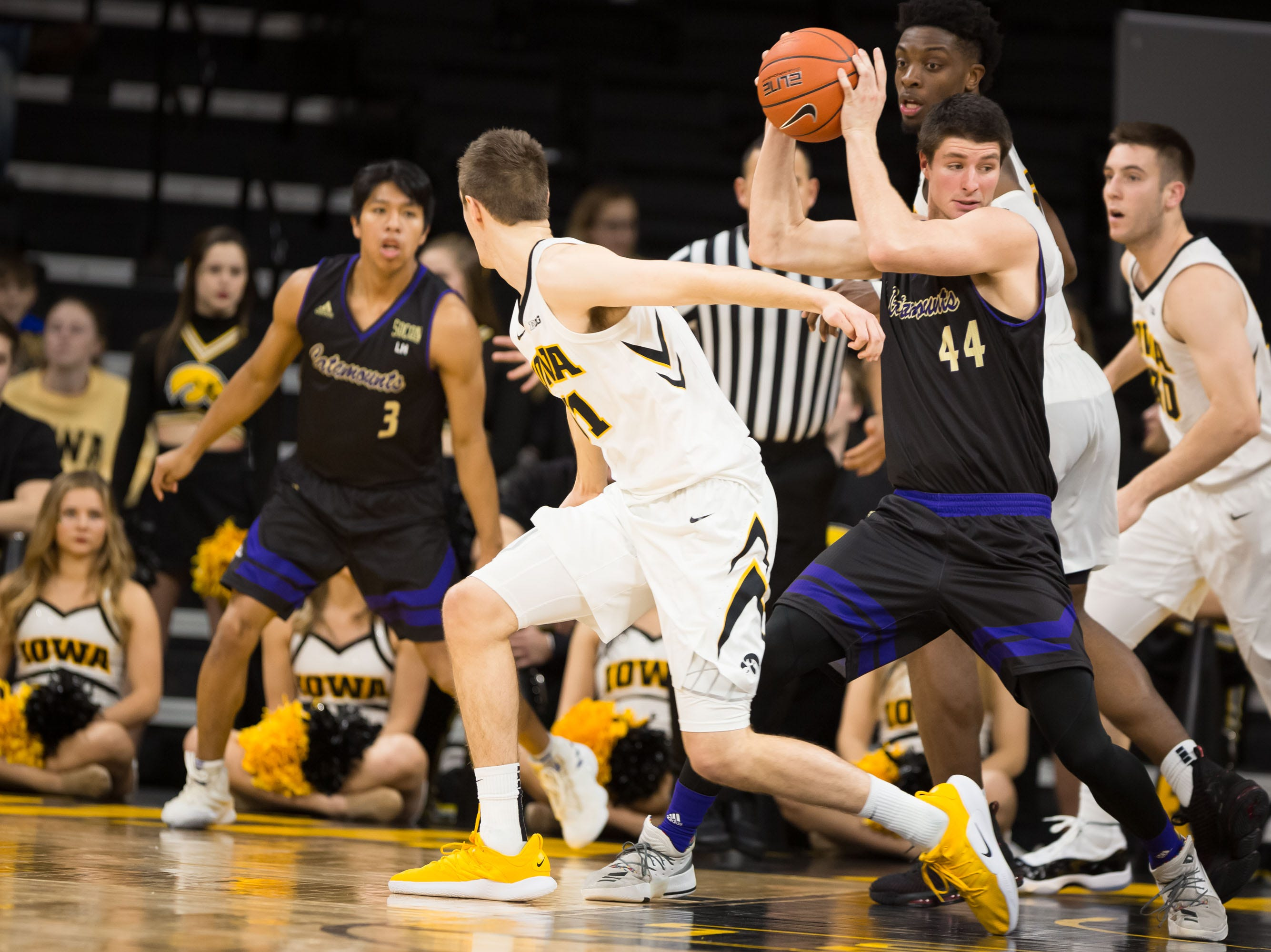 Western Carolina junior forward Adam Sledd (44) snatches the ball in the second half at Carver Hawkeye Arena in Iowa City on Tuesday, Dec. 18, 2018.