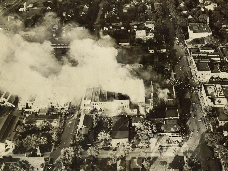 From 1931: Good News II flew to Spencer, Iowa to get photos of a devastating fire caused by a Fourth of July sparkler. Shortly after the fire, which started at Bjornstad Drug Store and caused more than $2 million in damages, Iowa lawmakers banned fireworks.