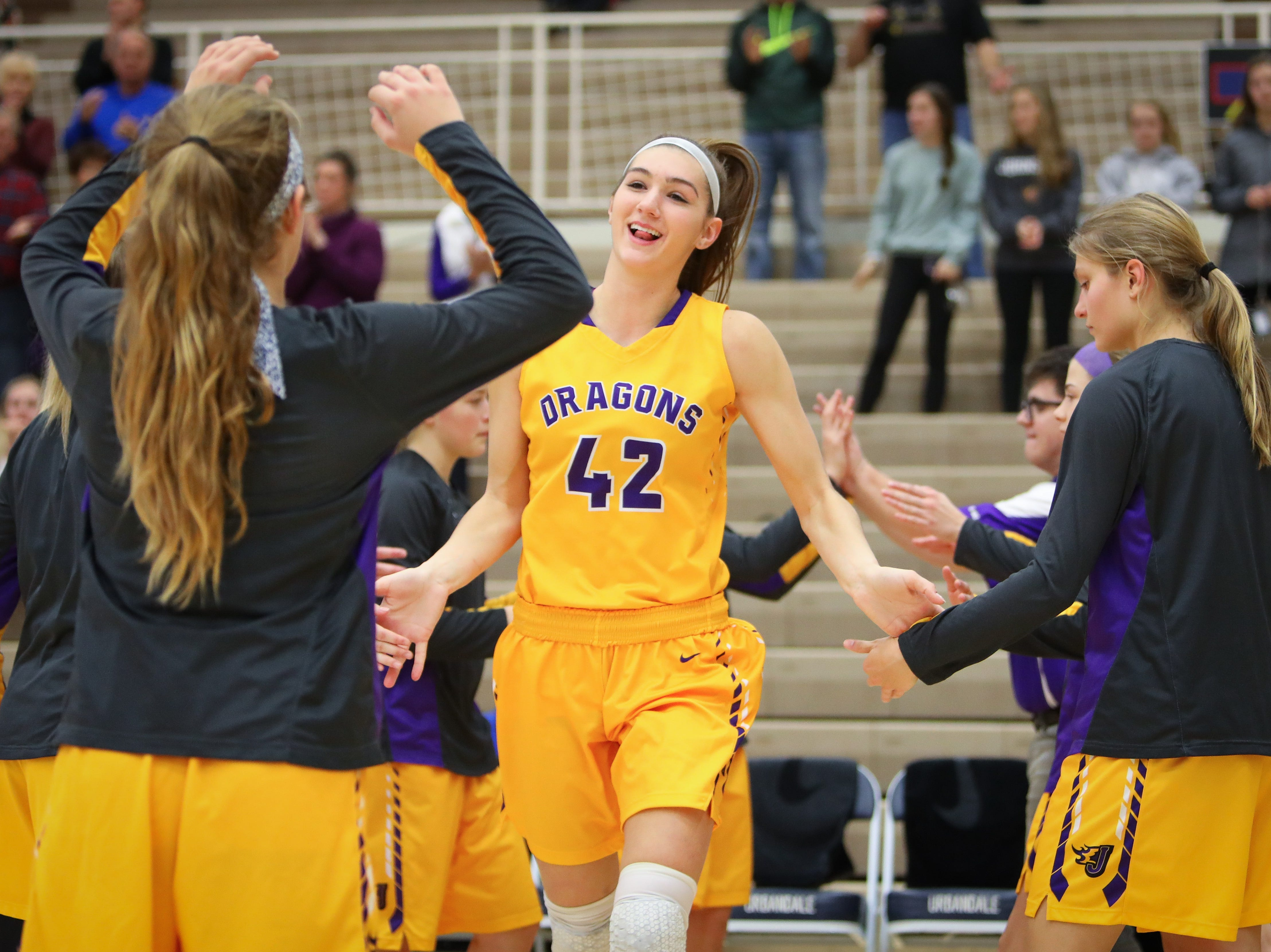Johnston senior Regan Nesheim smiles as she is introduced before a girls high school basketball game between the Johnston Dragons and the Urbandale J-Hawks at Urbandale High School on Dec. 18, 2018 in Urbandale, Iowa.