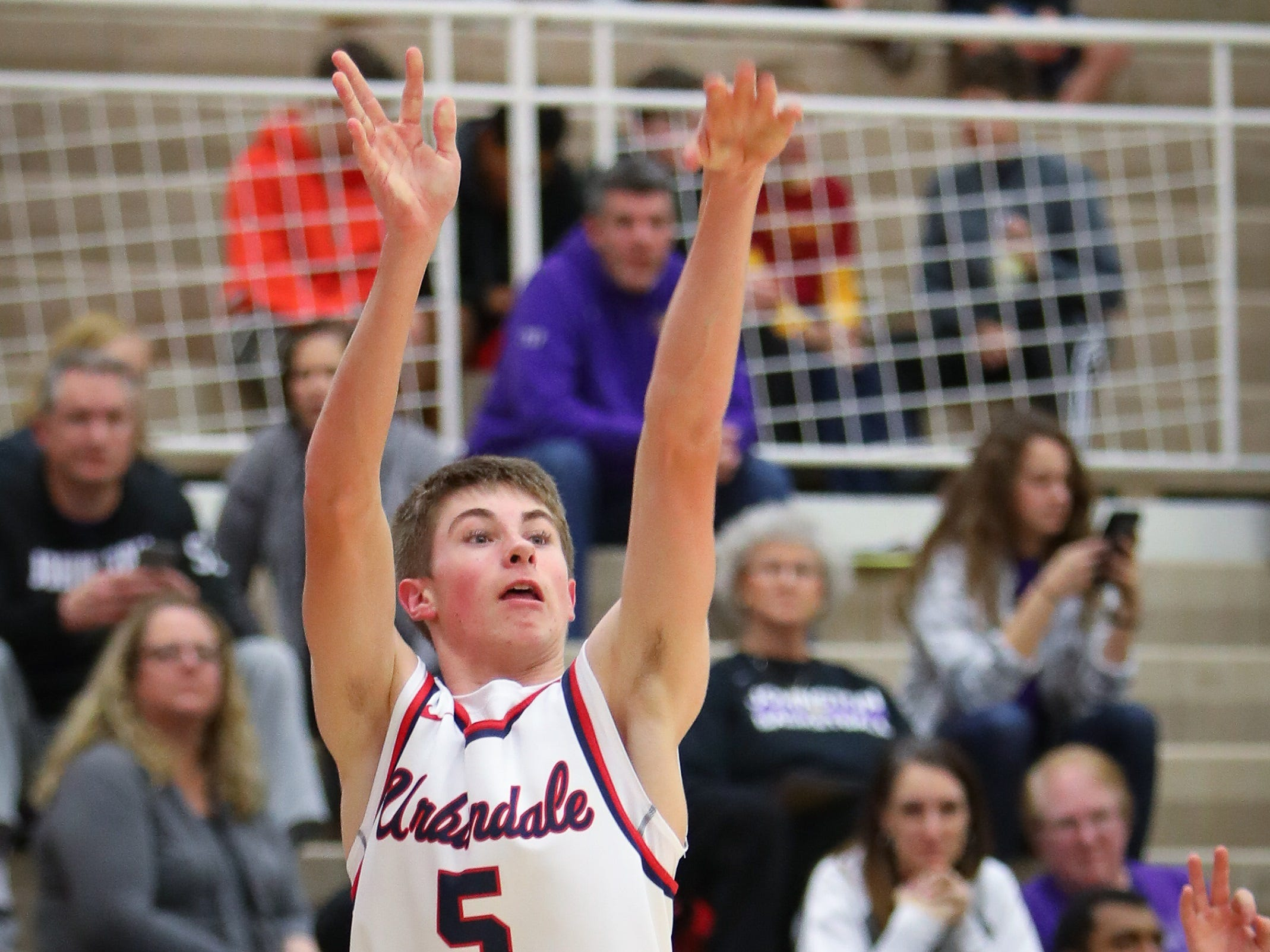 Urbandale sophomore Drew Dykstra attempts a three-pointer during a boys high school basketball game between the Johnston Dragons and the Urbandale J-Hawks at Urbandale High School on Dec. 18, 2018 in Urbandale, Iowa.