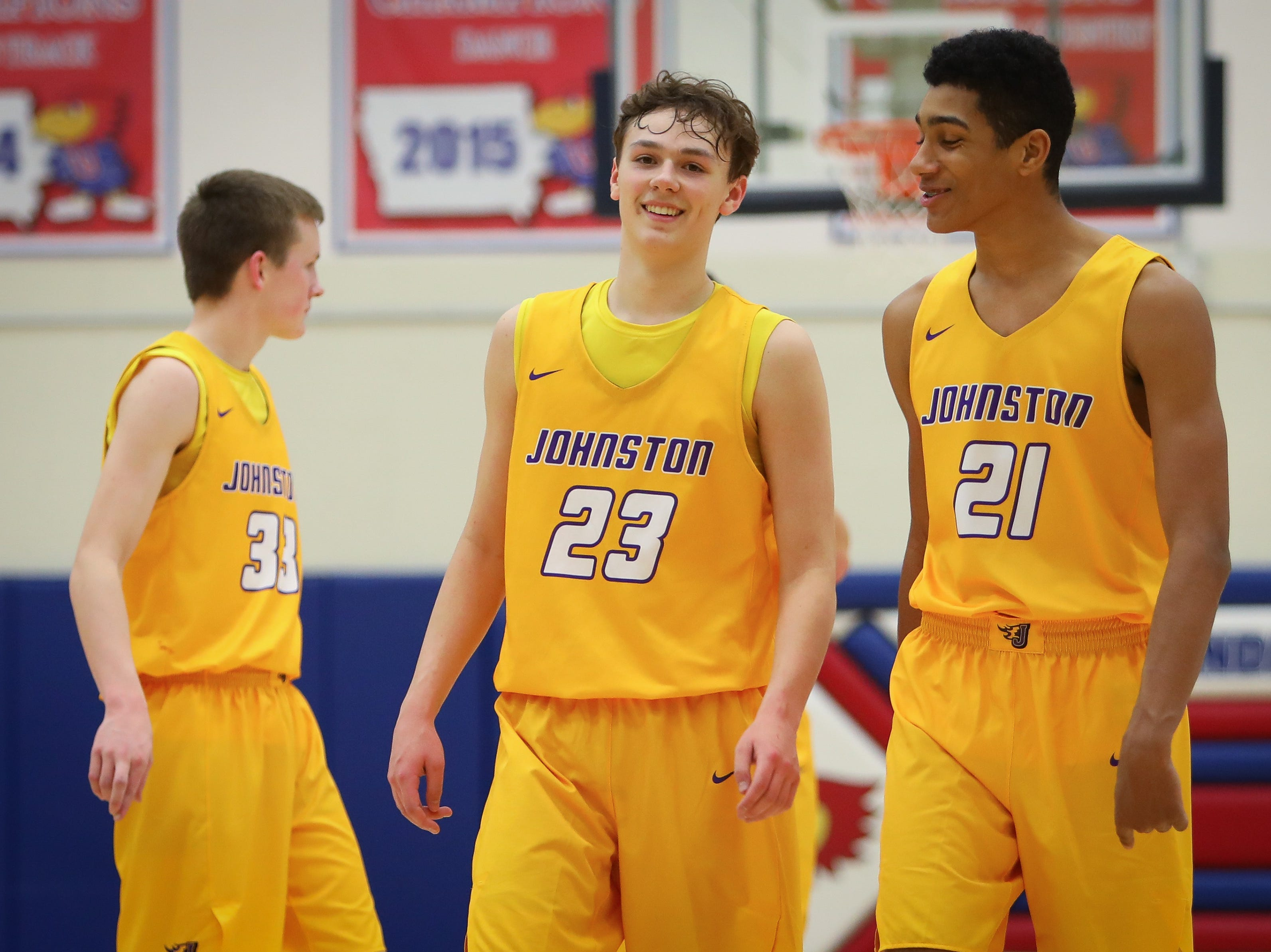 Johnston sophomore Reid Grant and junior Brees Proctor celebrate after the Dragons defeated the Urbandale J-Hawks, 59-53, in a boys high school basketball game at Urbandale High School on Dec. 18, 2018 in Urbandale, Iowa.