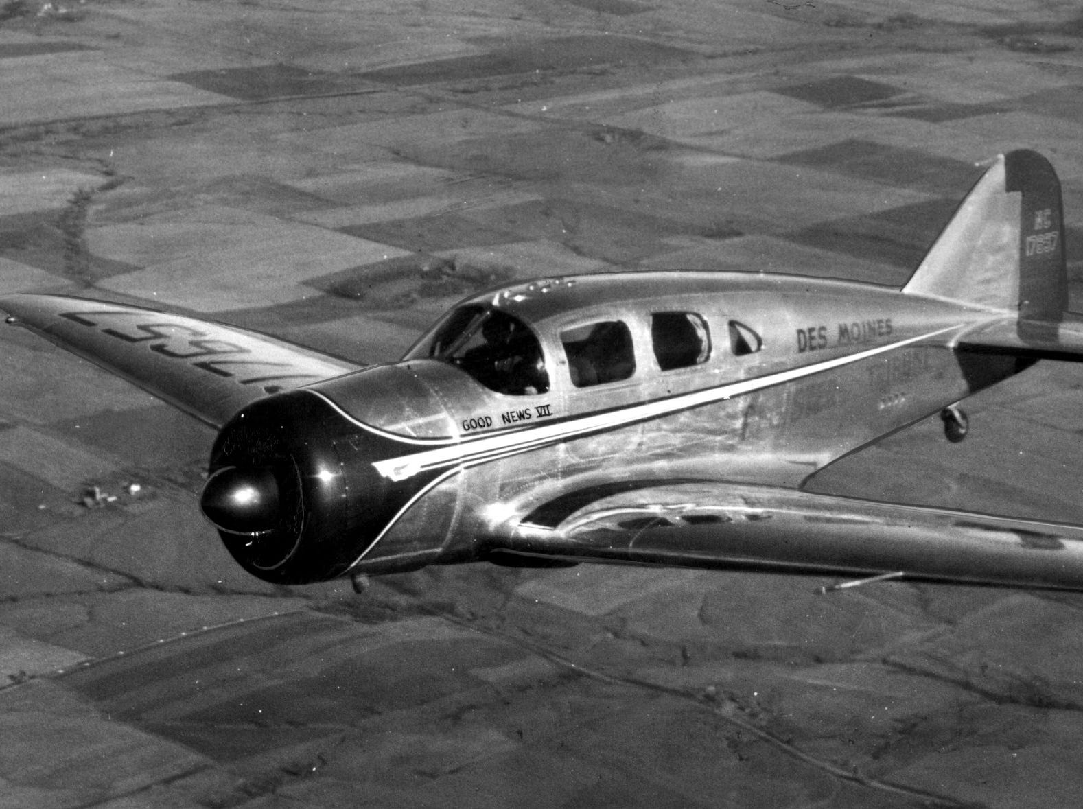 The Register and Tribune's new all-metal airplane, Good News VII, in flight over Des Moines.