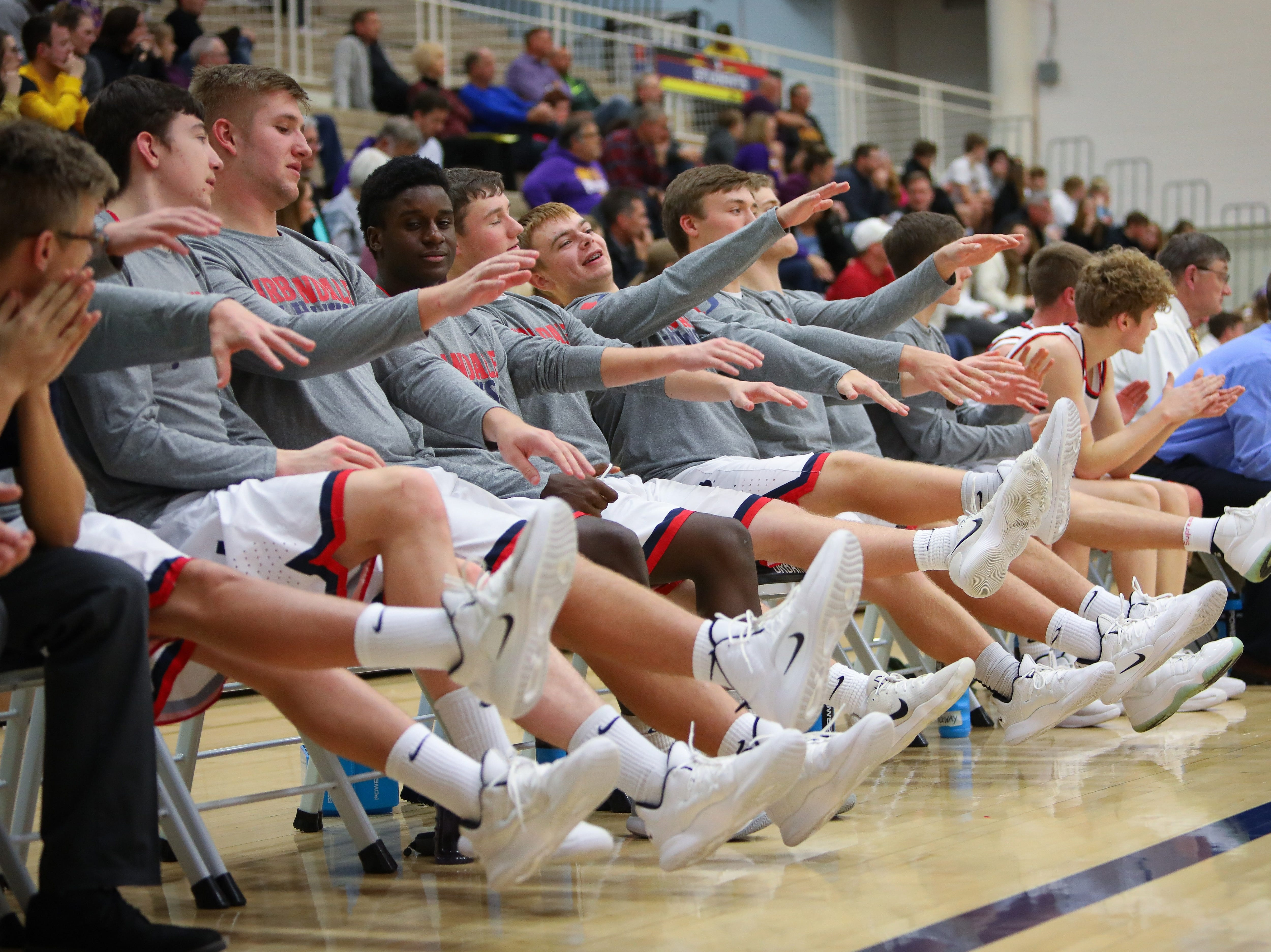 Members of the Urbandale bench celebrate after the J-Hawks drained a free throw against the Johnston Dragons during a boys high school basketball game at Urbandale High School on Dec. 18, 2018 in Urbandale, Iowa.