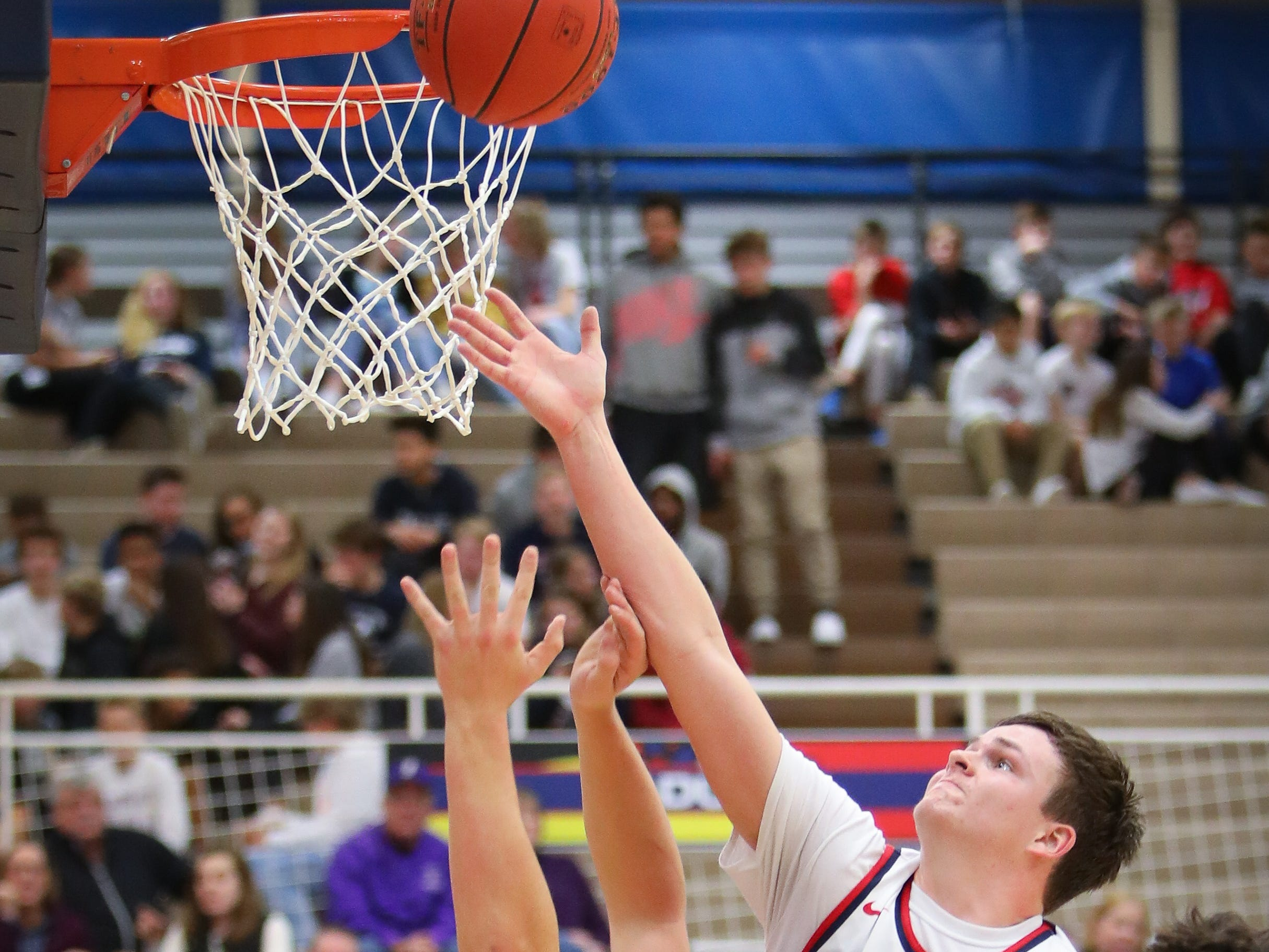 Urbandale senior Lucas Strain attempts to rebound the ball during a boys high school basketball game between the Johnston Dragons and the Urbandale J-Hawks at Urbandale High School on Dec. 18, 2018 in Urbandale, Iowa.