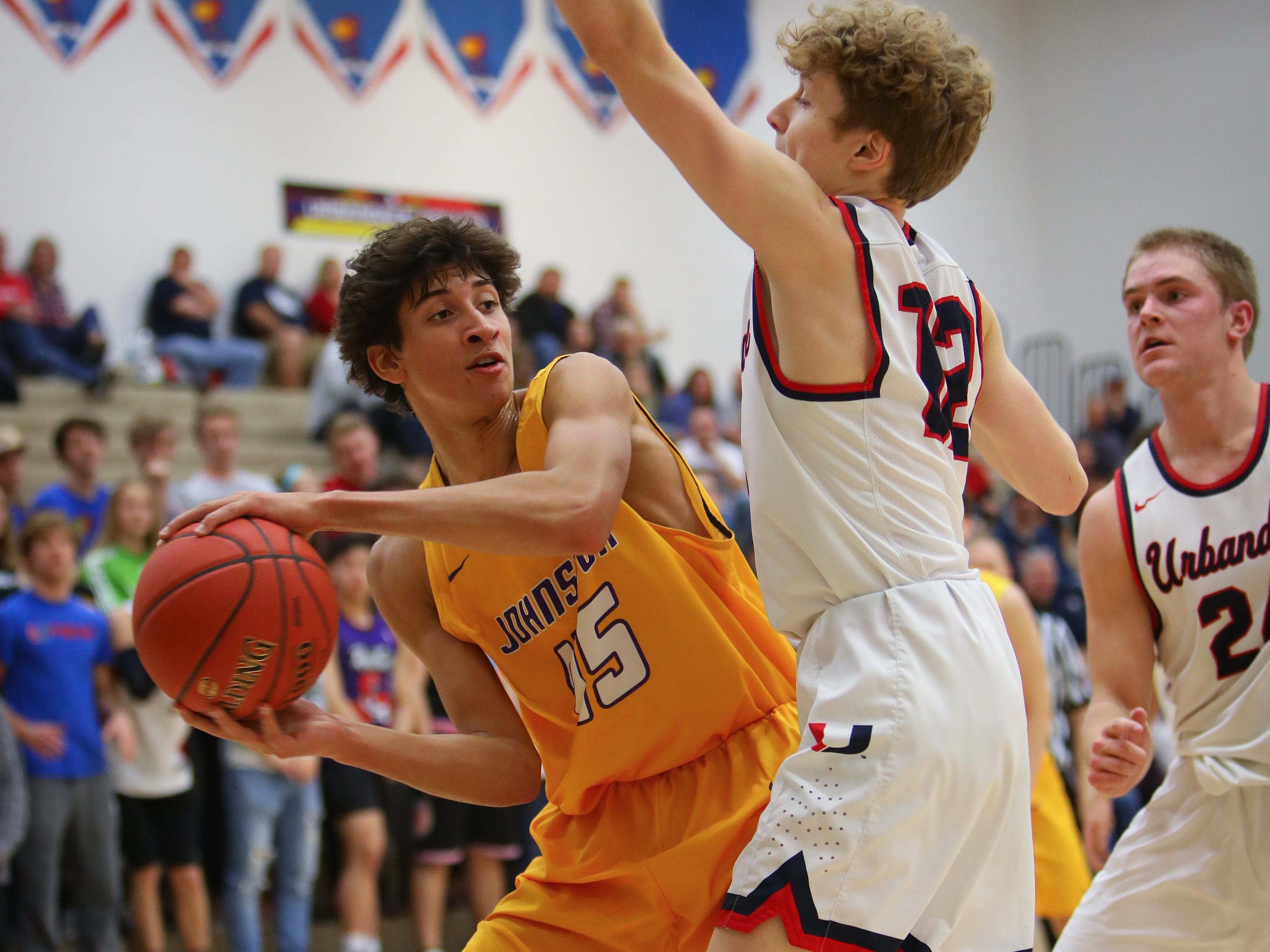 Johnston senior Ty Petty looks for an open teammate during a boys high school basketball game between the Johnston Dragons and the Urbandale J-Hawks at Urbandale High School on Dec. 18, 2018 in Urbandale, Iowa.