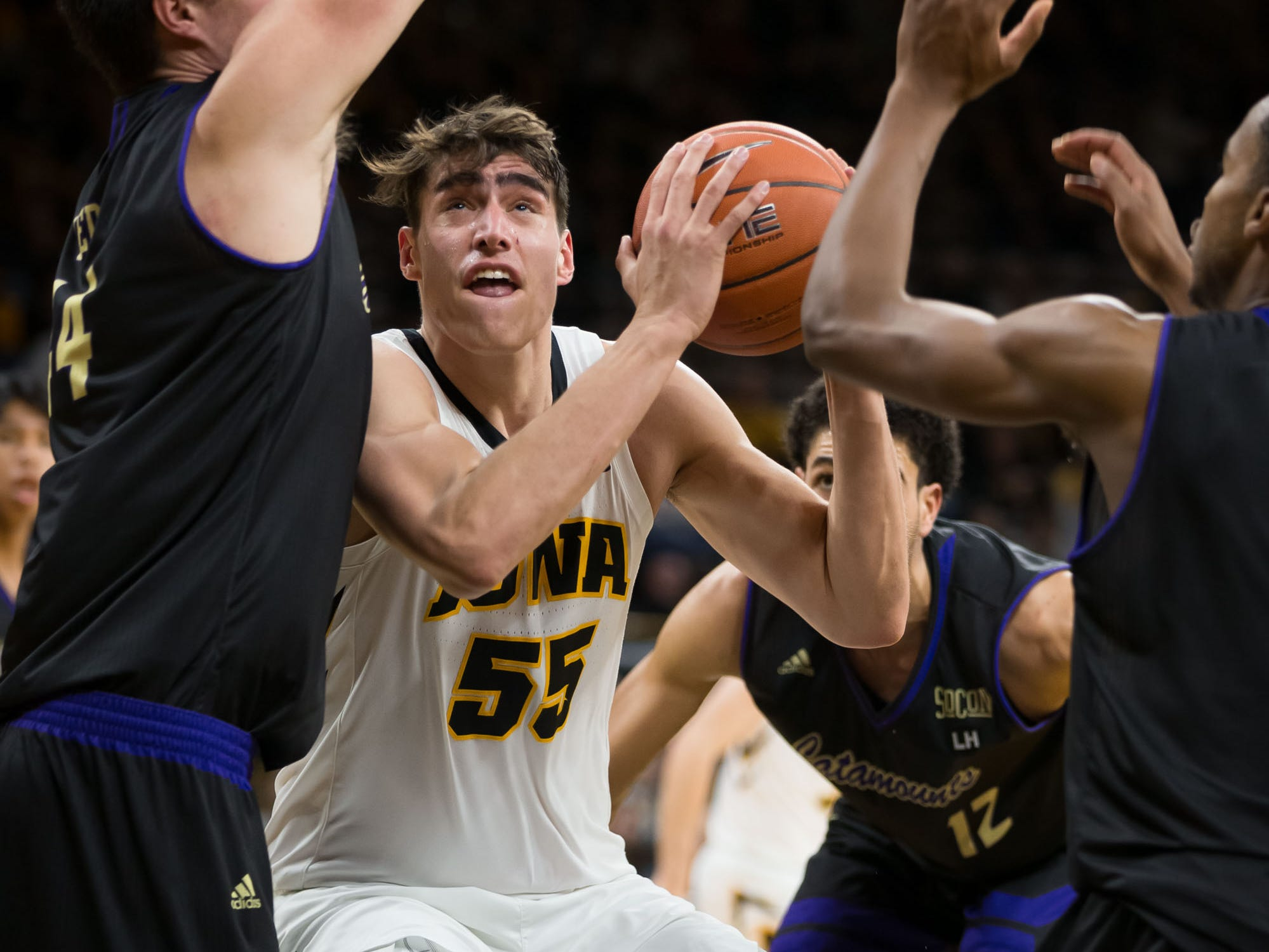 Iowa sophomore forward Luka Garza (55) clambors for a shot in traffic in the second half at Carver Hawkeye Arena in Iowa City on Tuesday, Dec. 18, 2018.