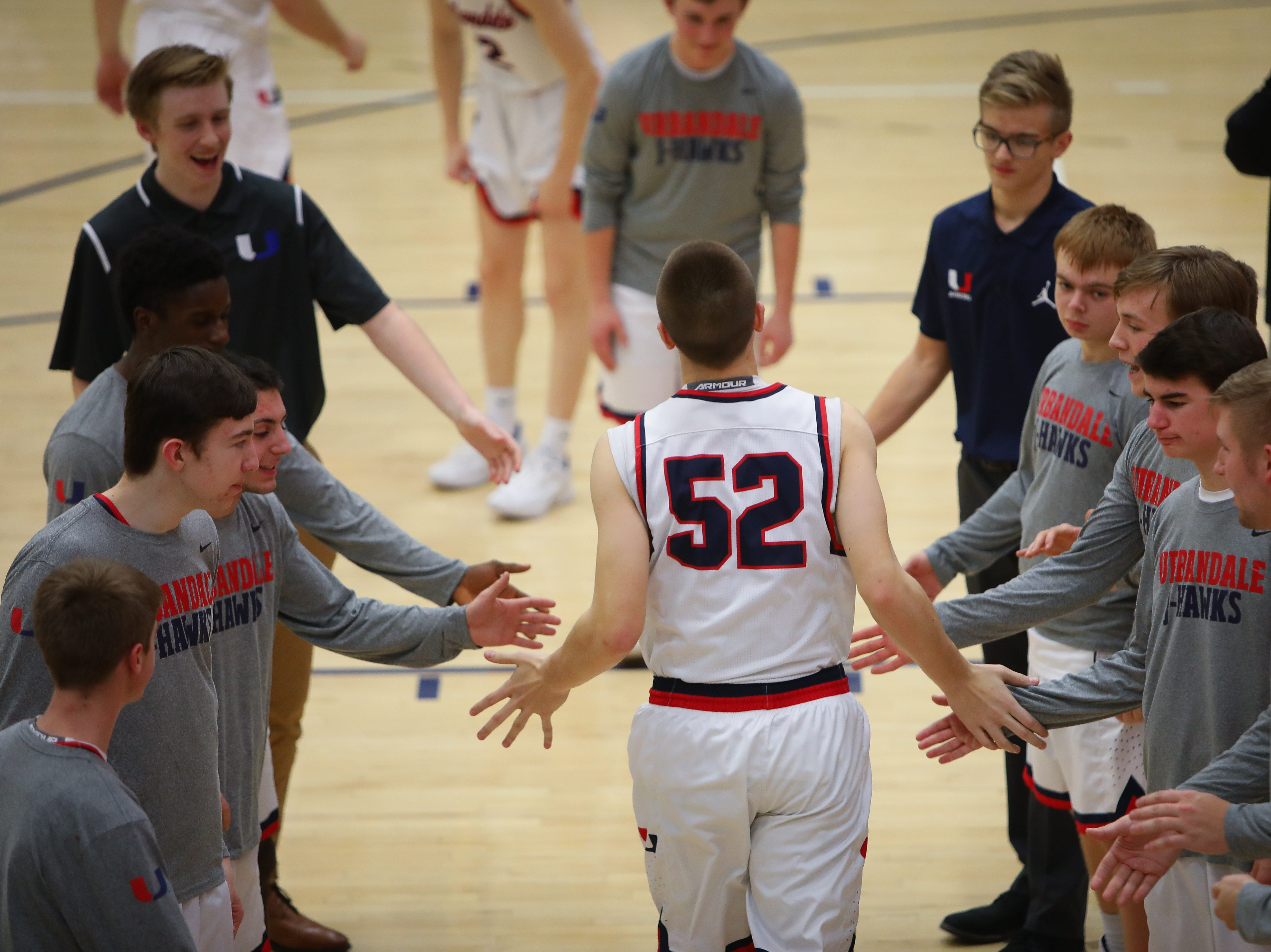 Urbandale junior Cal Watson is introduced before a boys high school basketball game between the Johnston Dragons and the Urbandale J-Hawks at Urbandale High School on Dec. 18, 2018 in Urbandale, Iowa.