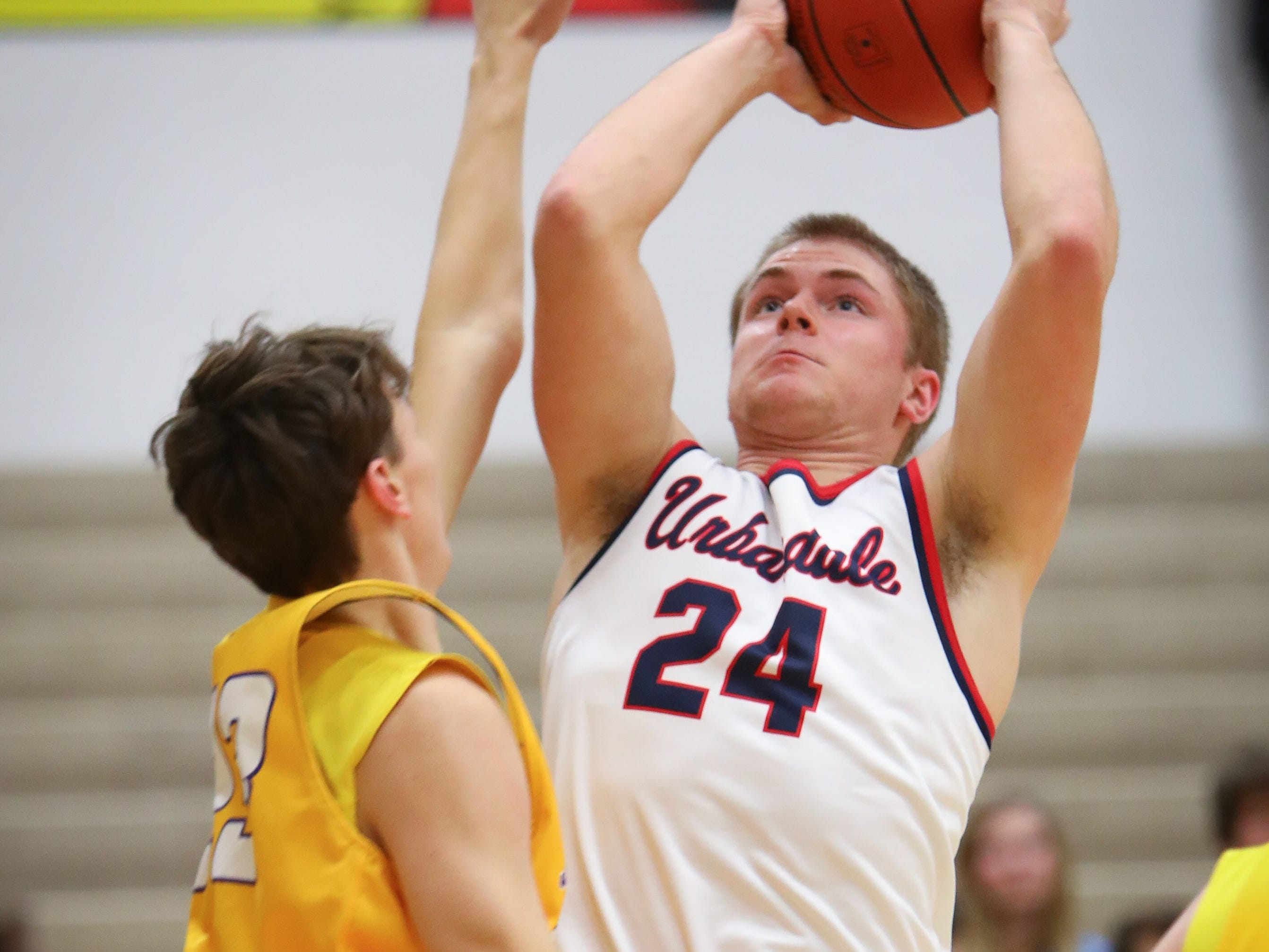 Urbandale senior Will Pattison attempts a field goal during a boys high school basketball game between the Johnston Dragons and the Urbandale J-Hawks at Urbandale High School on Dec. 18, 2018 in Urbandale, Iowa.