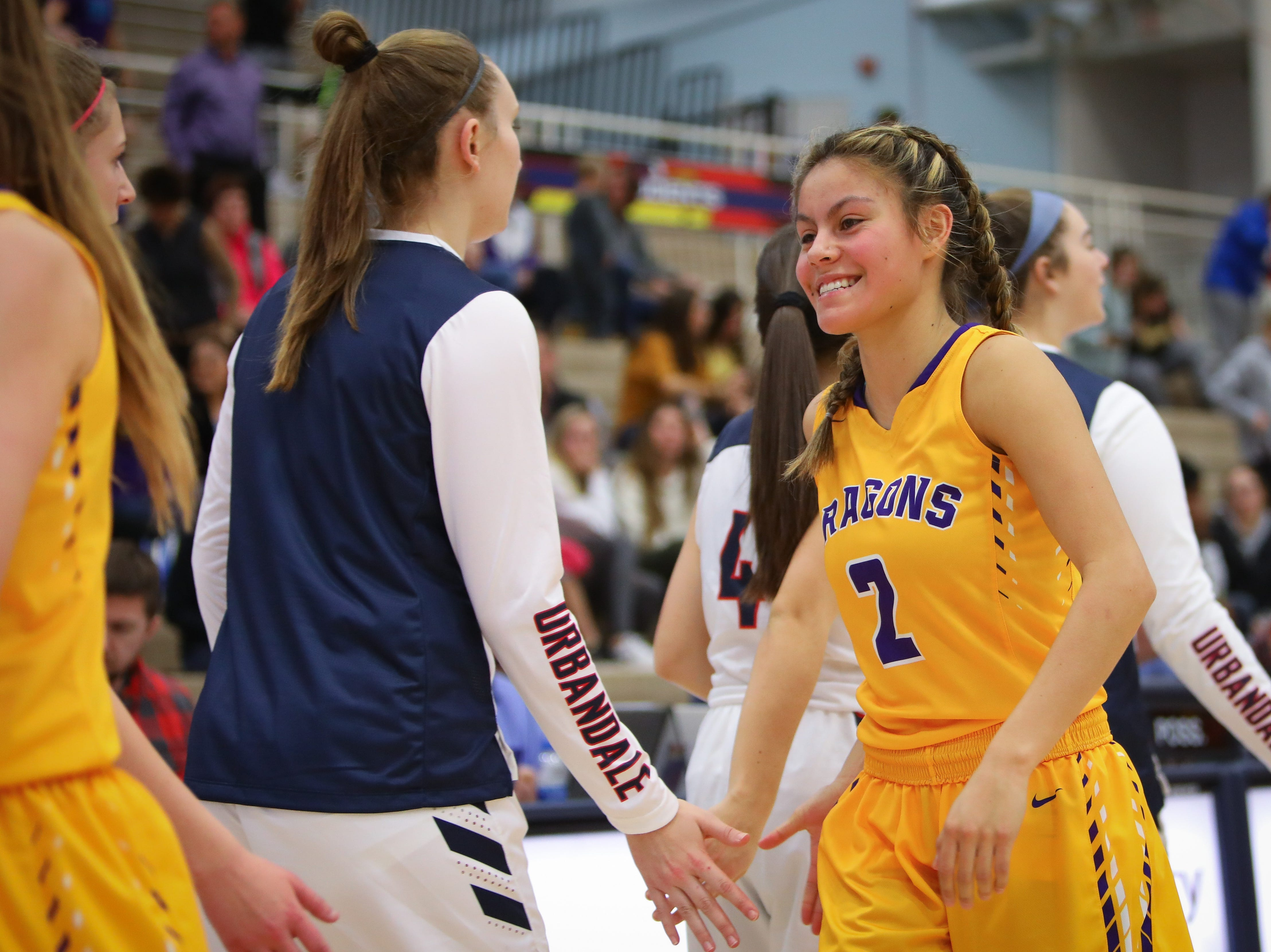 Johnston junior Maya McDermott celebrates after the Dragons defeated the Urbandale J-Hawks, 60-34, in a girls high school basketball game at Urbandale High School on Dec. 18, 2018 in Urbandale, Iowa.