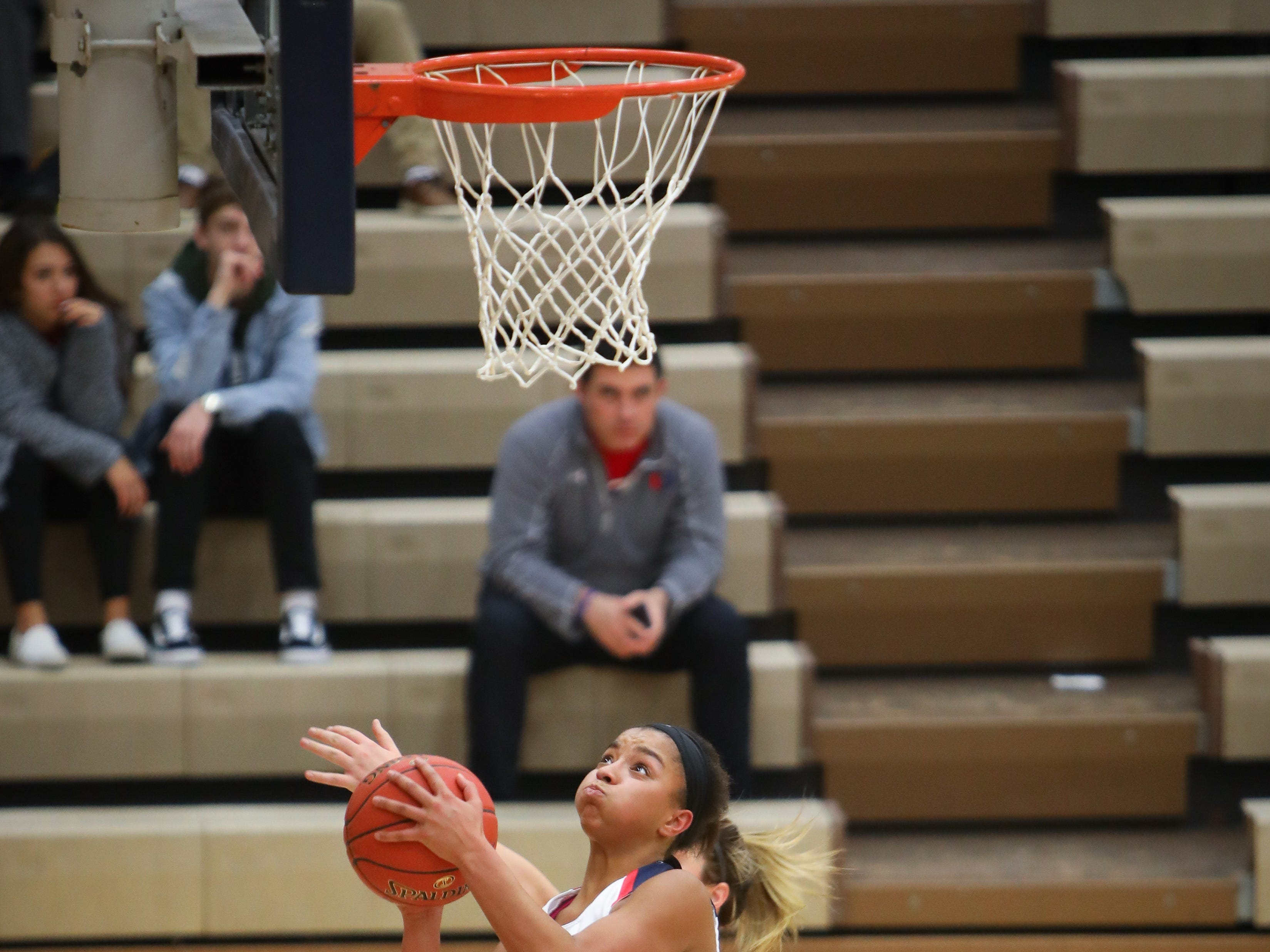Urbandale junior Faith Putz goes for a layup during a girls high school basketball game between the Johnston Dragons and the Urbandale J-Hawks at Urbandale High School on Dec. 18, 2018 in Urbandale, Iowa.