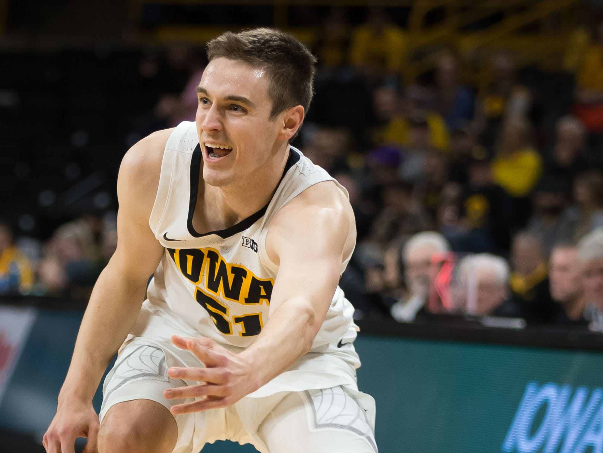 Iowa senior forward Nicholas Baer (51) pops a bounce pass in the second half at Carver Hawkeye Arena in Iowa City on Tuesday, Dec. 18, 2018.