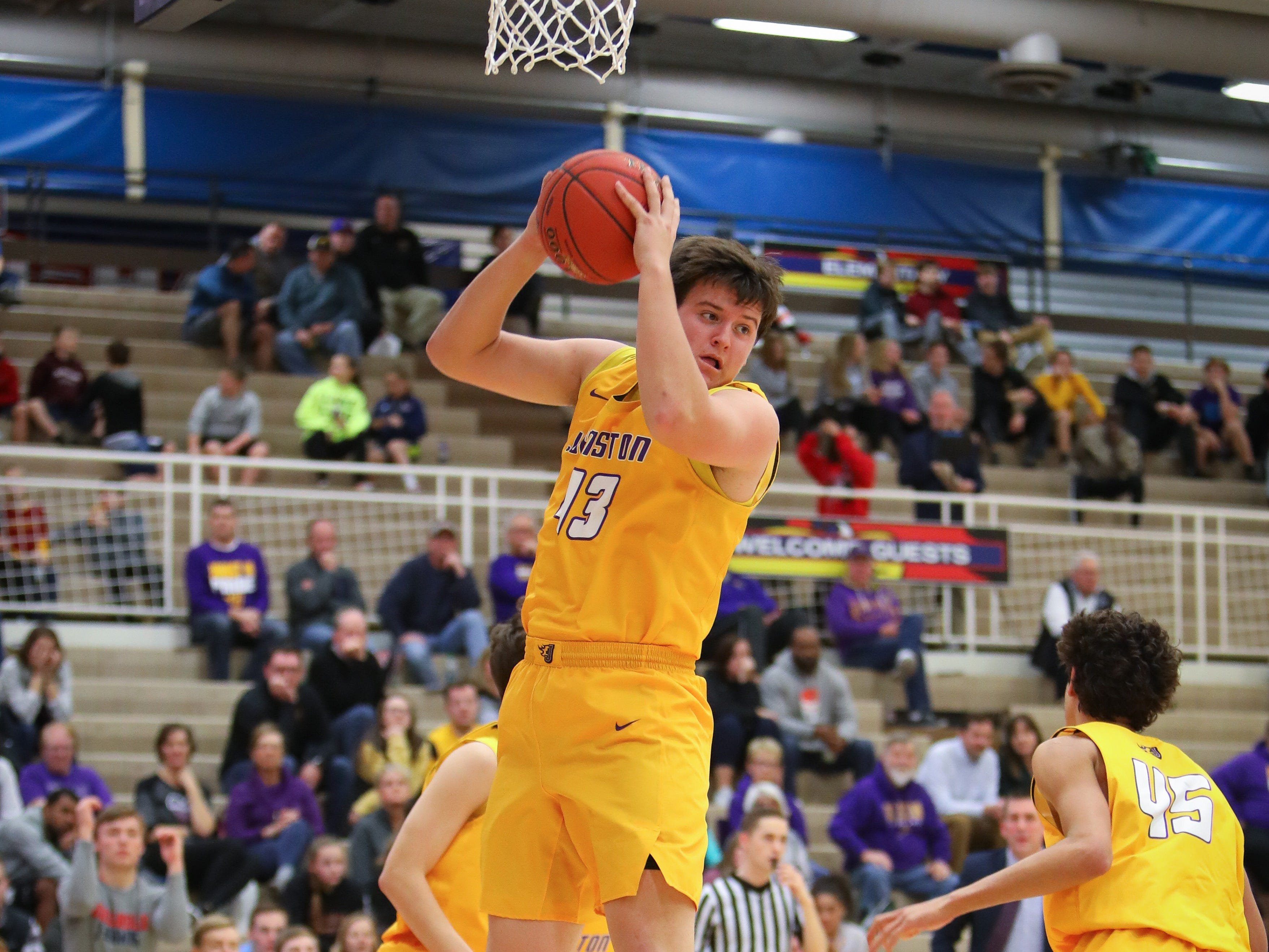 Johnston senior Peyton Williams comes down with a rebound during a boys high school basketball game between the Johnston Dragons and the Urbandale J-Hawks at Urbandale High School on Dec. 18, 2018 in Urbandale, Iowa.