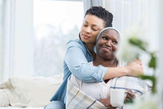 Mid Adult Woman Embraces Her Senior Mom