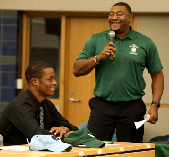 West Bloomfield football player Tre Mosley reacts to head coach Ron Bellamy talking about him before he signed his letter of intent to attend Michigan State on Wednesday, Dec. 19, 2018.