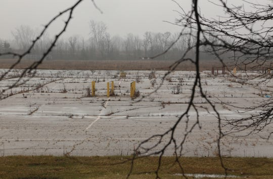 An abandoned parking lot where a Meijer grocery store once stood on Pierson Road in Mt. Morris Township is seen on Friday, December 14, 2018. The parking lot is where Robert Goodyear shot Michael Gaines in the head twice as they sat in a pickup truck, killing him, in 1987. Goodyear's girlfriend, Melissa Chapman, was convicted of first degree murder because she helped Goodyear (who also threatened to kill her) cover up the murder. She's now appealing for clemency and hopes Gov. Snyder will commute her life without parole sentence.