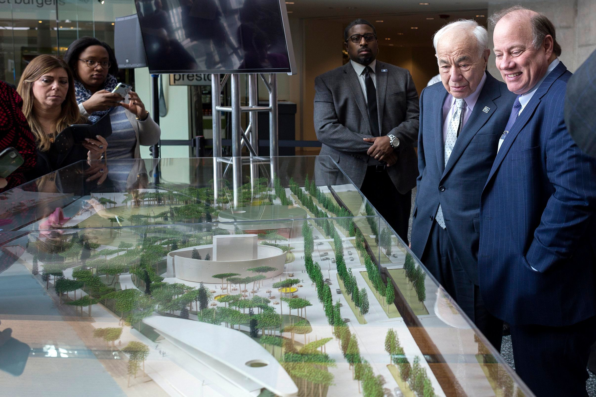 Ralph C. Wilson Jr. Foundation Trustee, Eugene Driker, left, stands next to Detroit Mayor Mike Duggan, as people gather around the West Riverfront Park model by the winning firm Michael Van Valkenburgh Associates on Tuesday, April 10, 2018 at the General Motors Renaissance Center in Detroit. Michael Van Valkeburgh Associates and David Adjaye, Principal of Adjaye Associates will reimagine the 22 acre West Riverfront Park in Detroit.