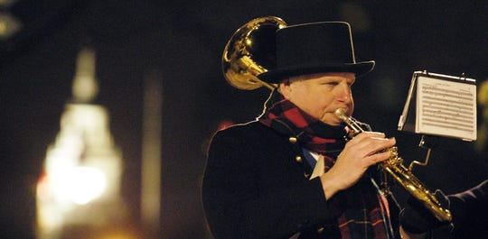Strolling musicians and carolers bring Christmas cheer to Holiday Nights in Greenfield Village.